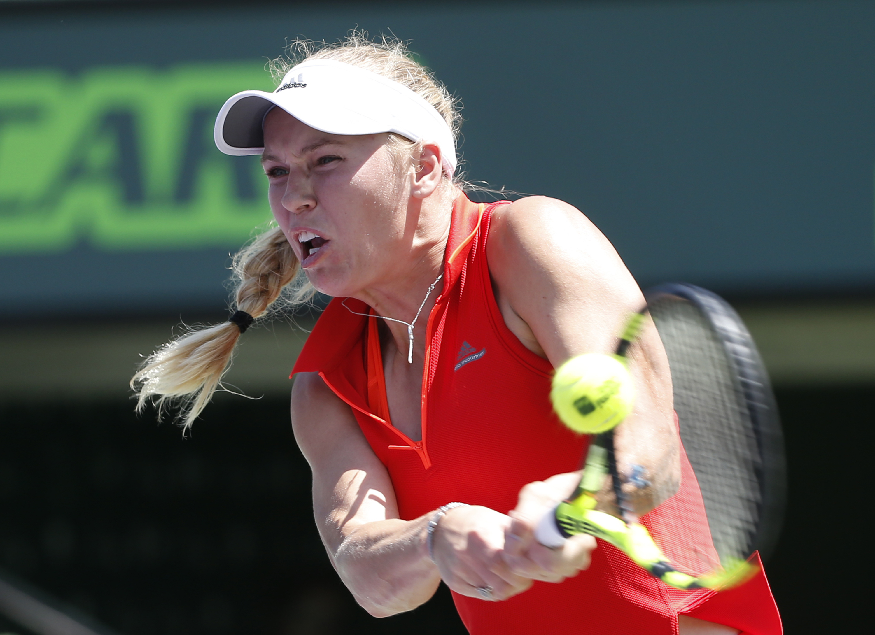 Caroline Wozniacki, of Denmark, returns a shot from Garbine Muguruza, of Spain, during a tennis match at the Miami Open, Monday, March 27, 2017, in Key Biscayne, Fla. (AP Photo/Wilfredo Lee)