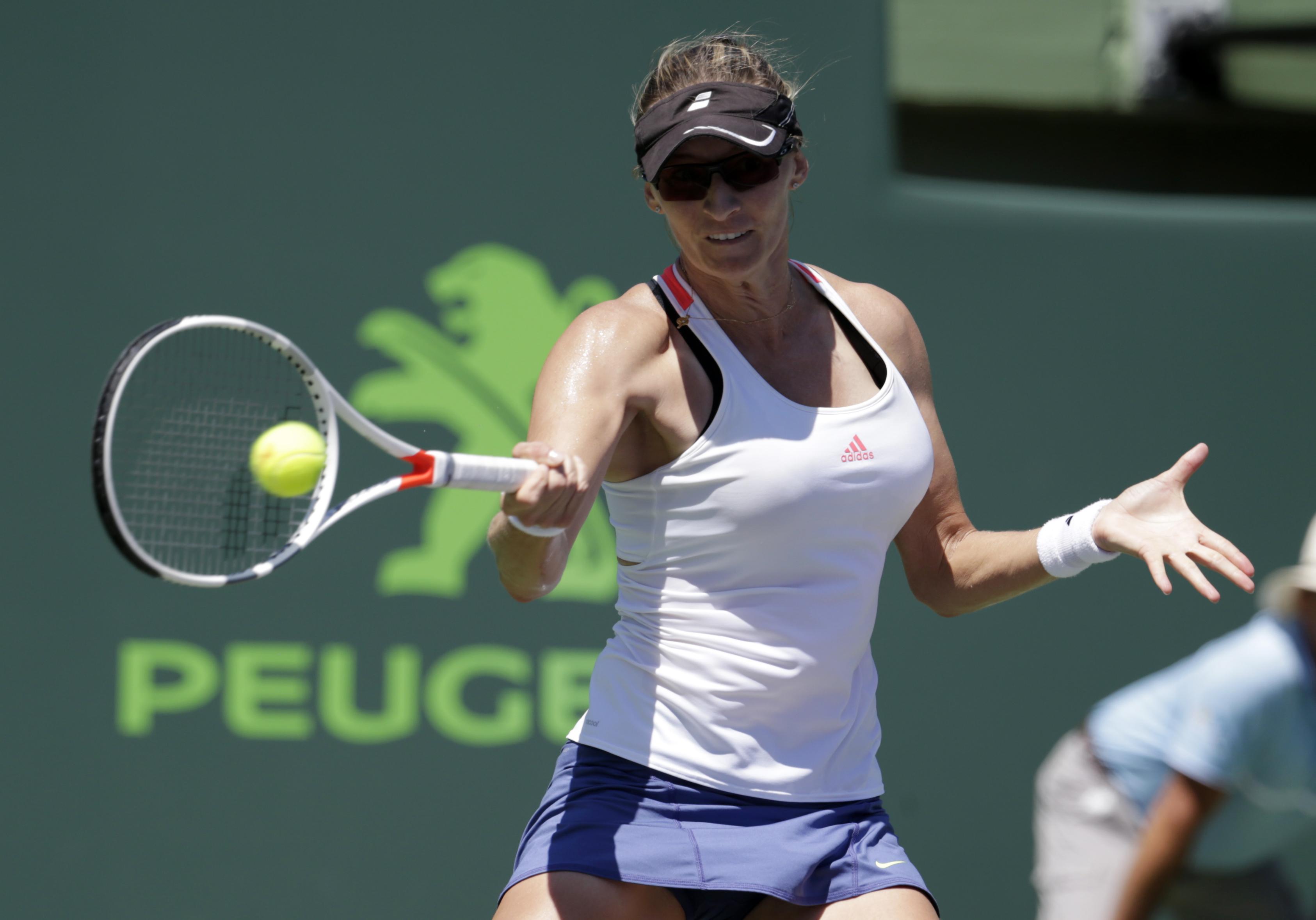 Mirjana Lucic-Baroni, of Croatia, hits a return to Carolina Pliskova during the Miami Open tennis tournament, Tuesday, March 28, 2017, in Key Biscayne, Fla. Pliskova won 6-3, 6-4. (AP Photo/Lynne Sladky)