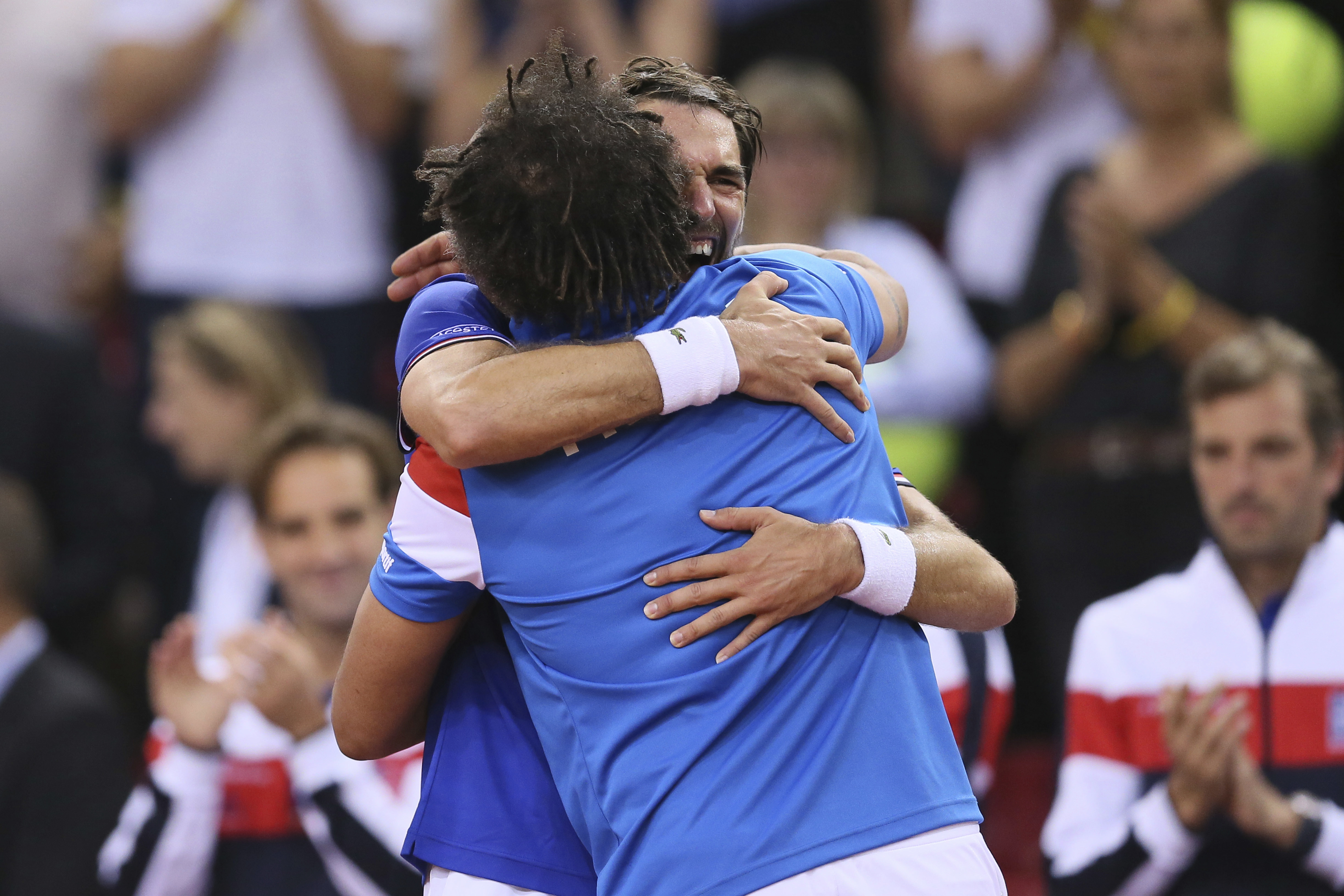 Jeremy Chardy of France jubilates with Yannick Noah at the end of their Davis Cup quarterfinal tennis match between France and Britain at the Kindarena Stadium of Rouen, France, Friday, April 7, 2017. (AP Photo/David Vincent)