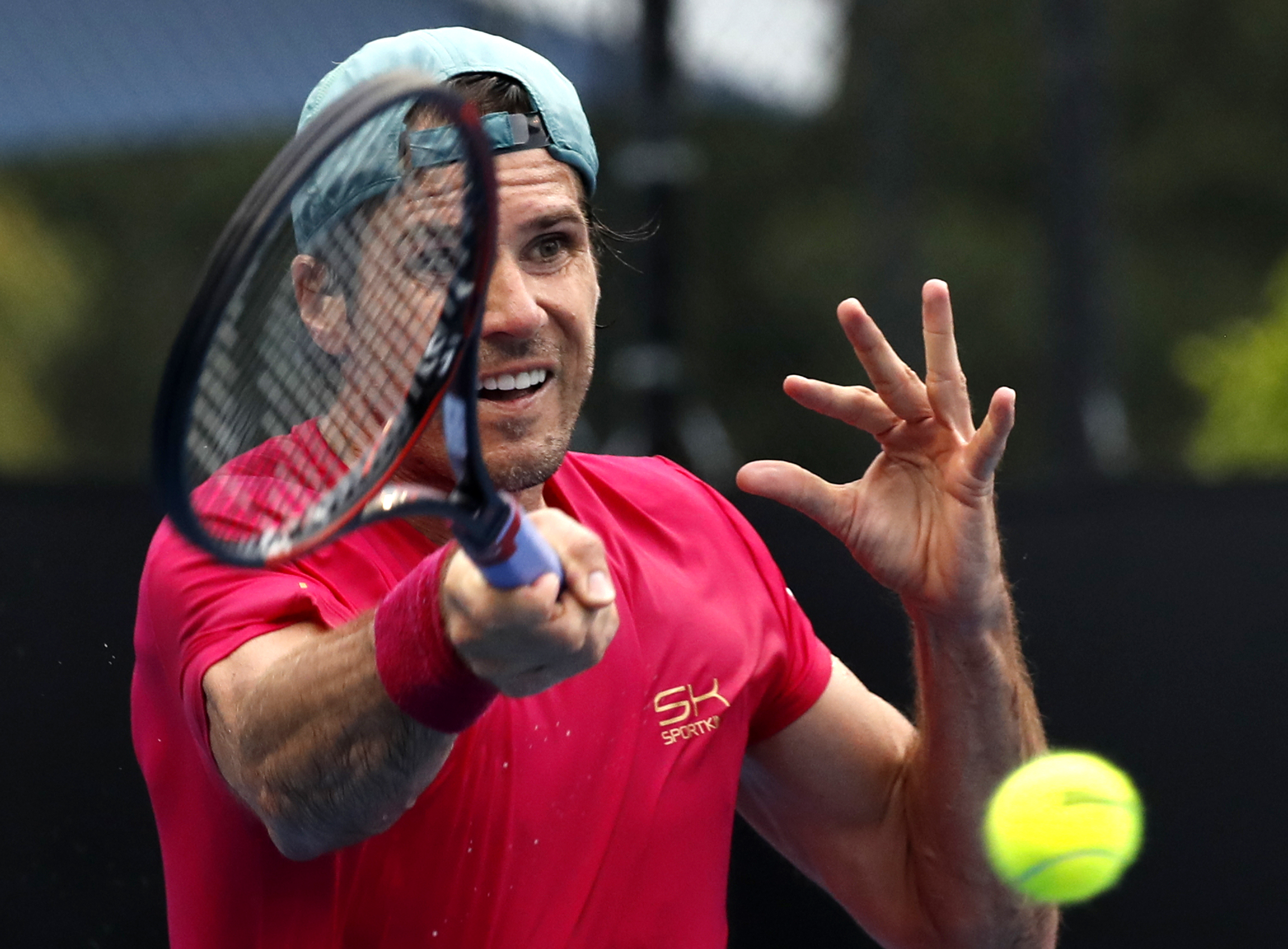 Germany's Tommy Haas makes a forehand return to France's Benoit Paire during their first round match at the Australian Open tennis championships in Melbourne, Australia, Tuesday, Jan. 17, 2017. (AP Photo/Kin Cheung)