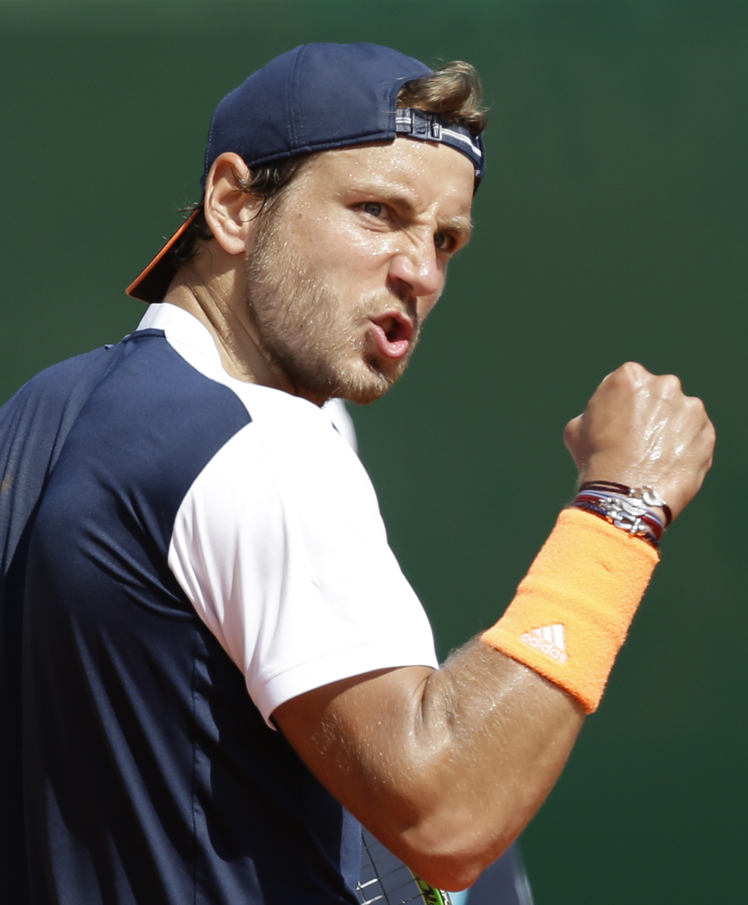 France's Lucas Pouille clenches his fist after winning a point against Spain's Albert Ramos-Vinolas during their semifinal match of the Monte Carlo Tennis Masters tournament in Monaco, Saturday, April, 22, 2017. (AP Photo/Claude Paris)