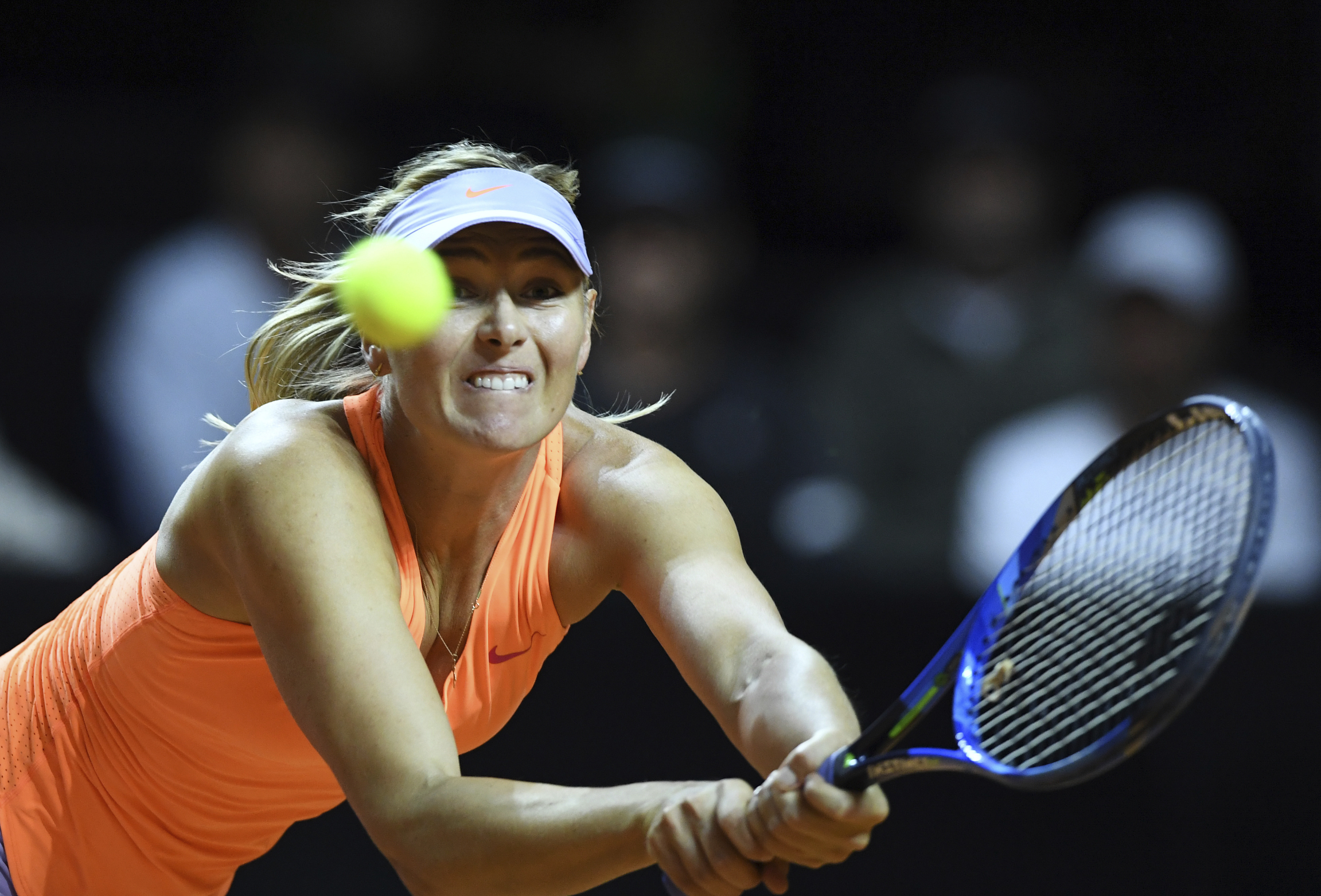 Russia's Maria Sharapova returns the ball to Estonia's Anett Kontaveit during their quarterfinal match at the WTA tennis tournament in Stuttgart, Germany, Friday, April 28, 2017. (Bernd Weissbrod/dpa via AP)