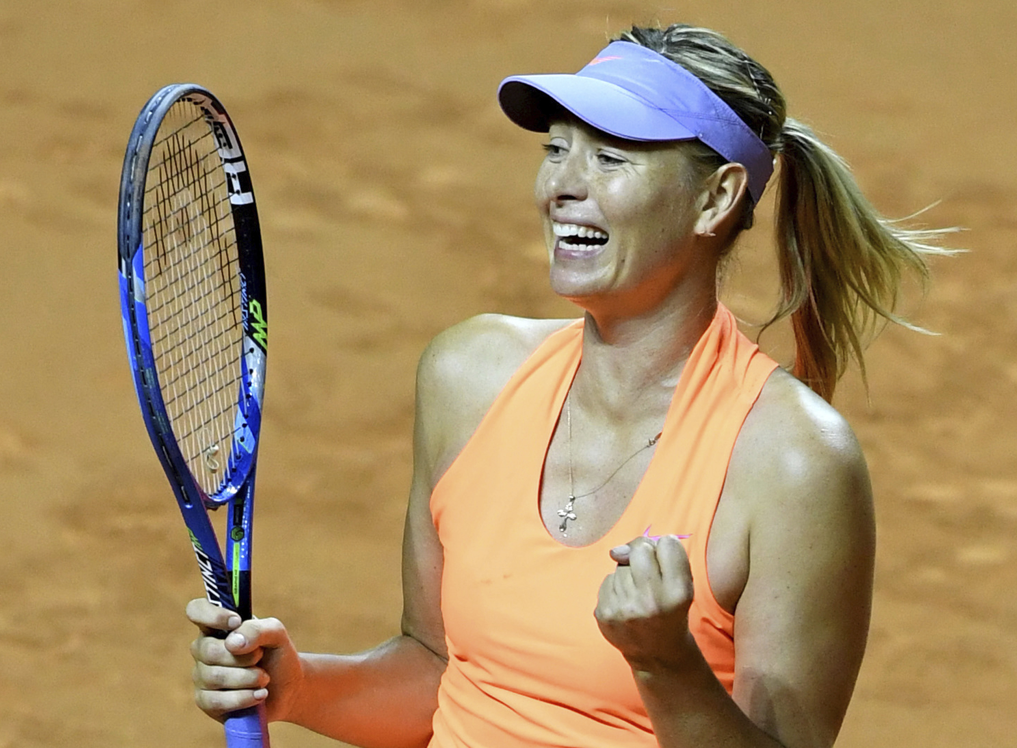 Russia's Maria Sharapova celebrates her victory against Estonia's Anett Kontaveit during their quarterfinal match at the WTA tennis tournament in Stuttgart, Germany, Friday, April 28, 2017. (Bernd Weissbrod/dpa via AP)