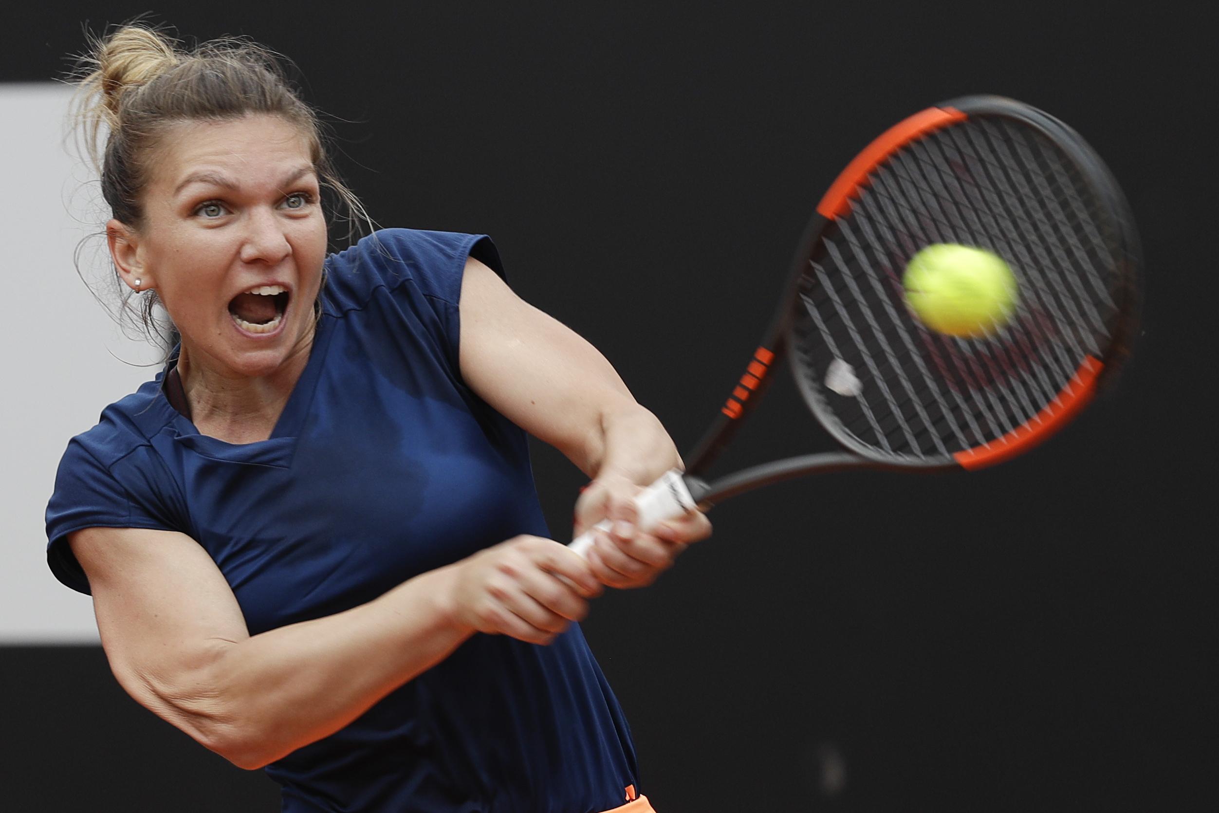 Romania's Simona Halep returns the ball during her semifinal match against Netherlands Kiki Bertens at the Italian Open tennis tournament, in Rome, Saturday, May 20, 2017. (AP Photo/Gregorio Borgia)
