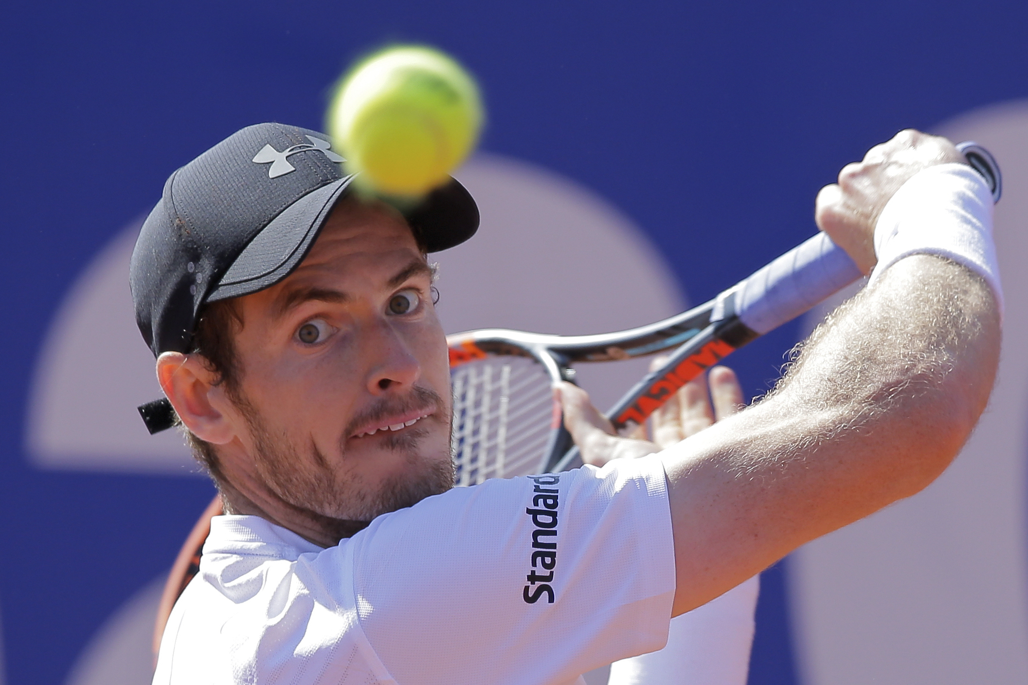 FILE - In this Friday, April 28, 2017 file photo, Andy Murray of Britain eyes the ball before playing a return shot to Albert Ramos-Vinolas of Spain during a quarterfinal match at the Barcelona Open Tennis Tournament in Barcelona, Spain. After months of d
