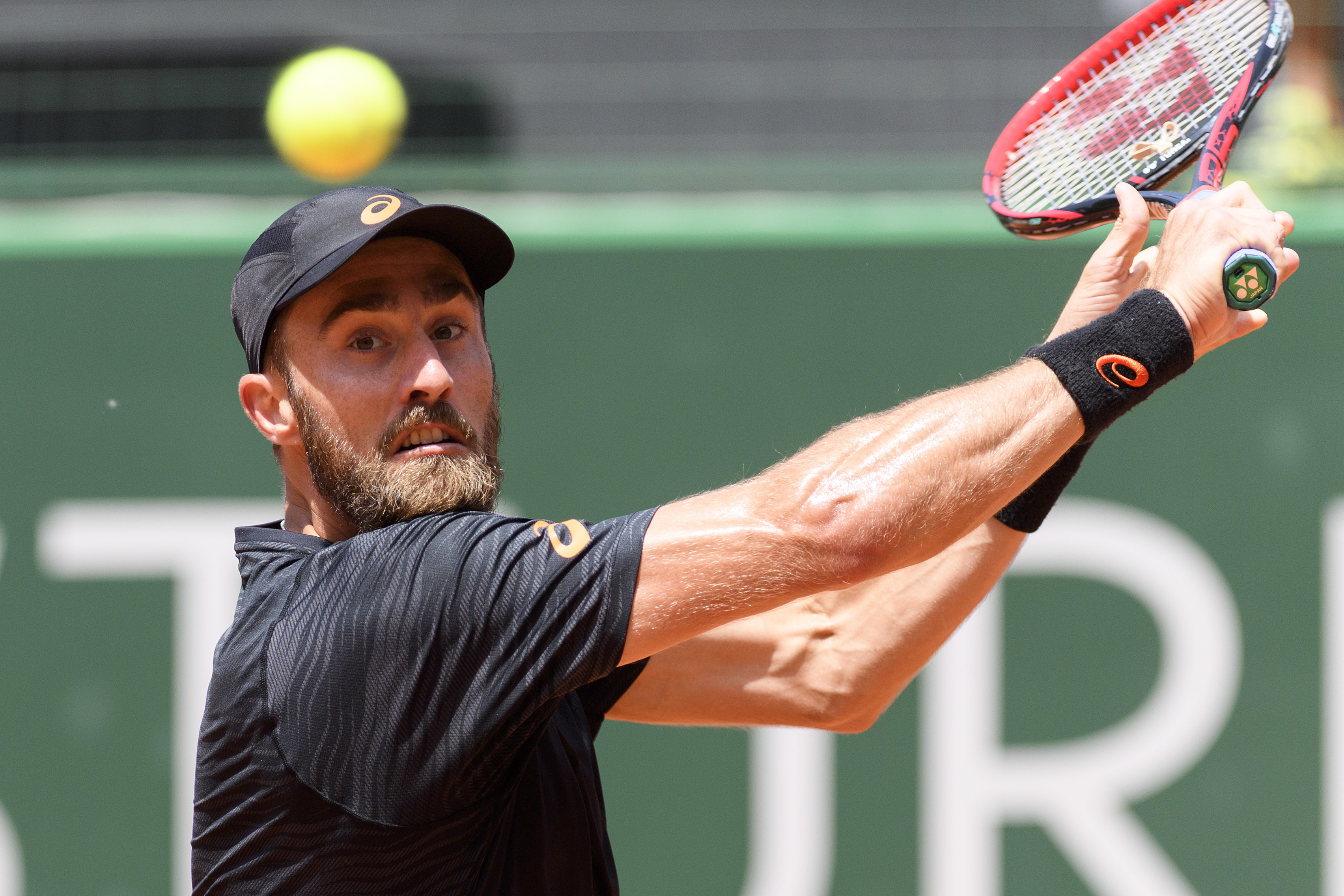 Steve Johnson of the U.S, returns a ball to Mischa Zverev of Germany, during a quarterfinal match of the Geneva Open ATP 250 tennis tournament, in Geneva, Switzerland, Thursday, May 25, 2016. (Martial Trezzini/Keystone via AP)