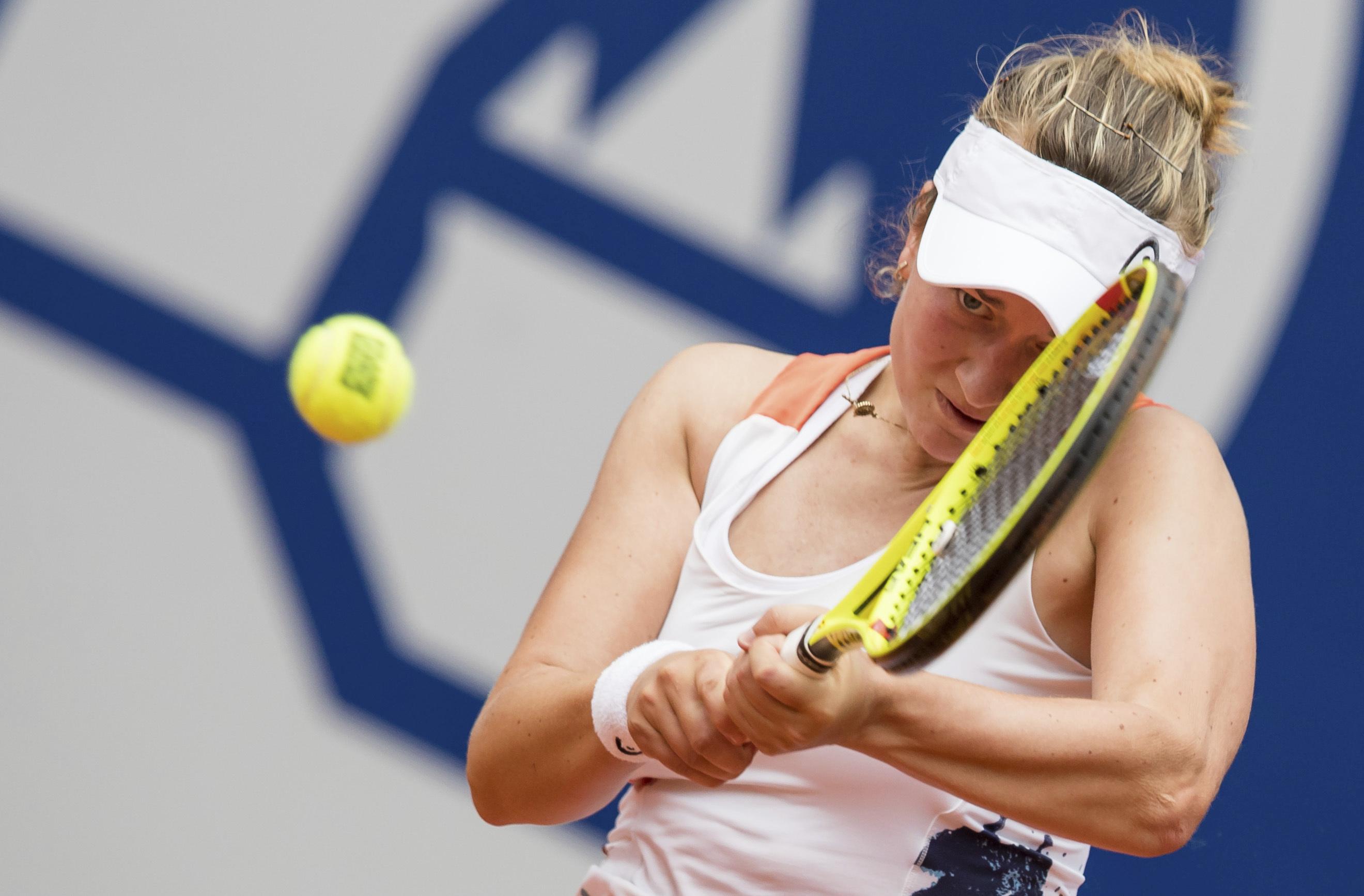 Czech player Barbora Krejcikova returns a ball to Germany's  Carina Witthoeft, during their quarterfinal  match at the Nuremberg Cup tennis tournament in Nuremberg, Germany, Thursday, May 25, 2017. ( Daniel Karmann/dpa via AP)