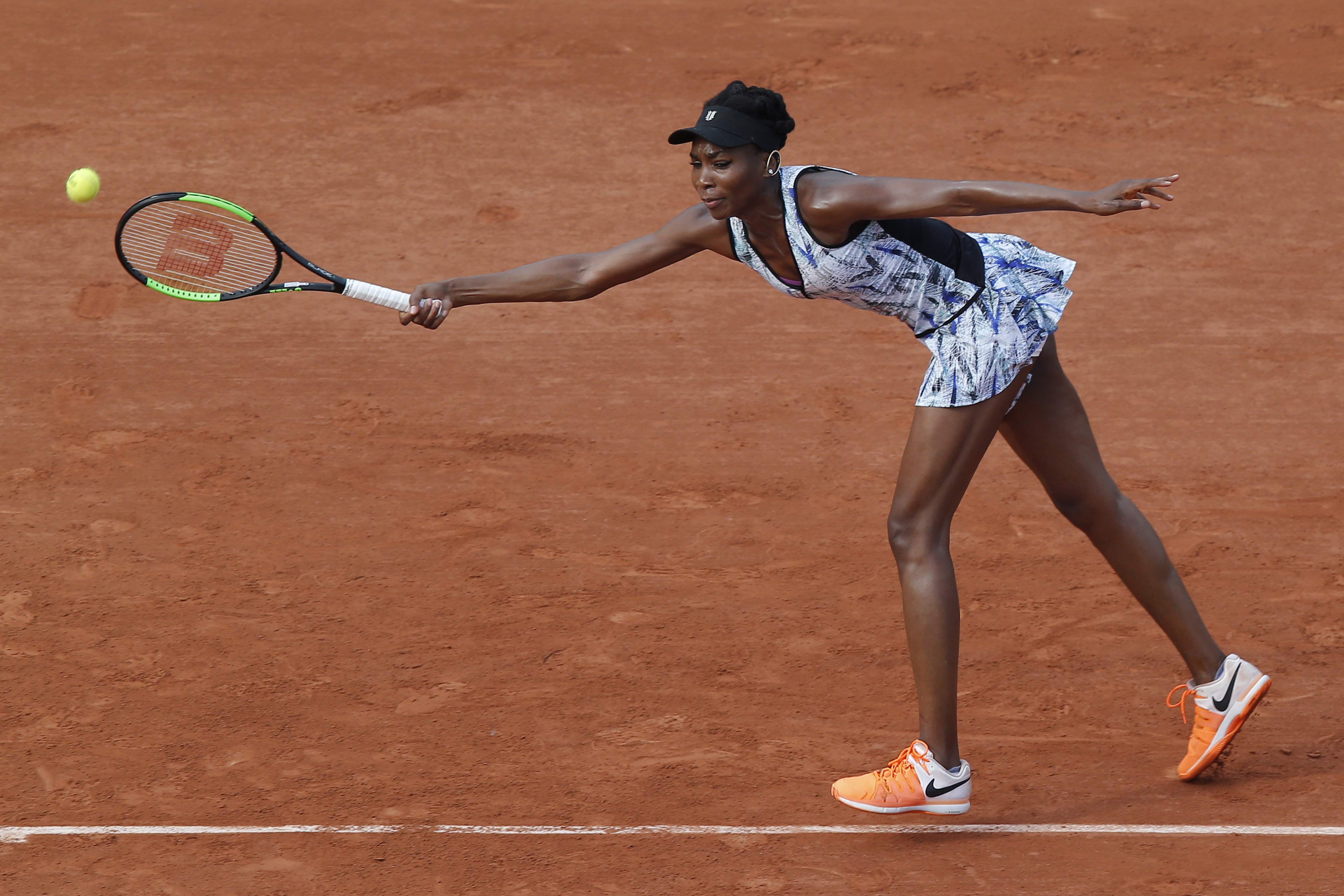 Venus Williams of the U.S. plays a shot against China's Qiang Wang during their first round match of the French Open tennis tournament at the Roland Garros stadium, in Paris, France. Sunday, May 28, 2017. (AP Photo/Michel Euler)