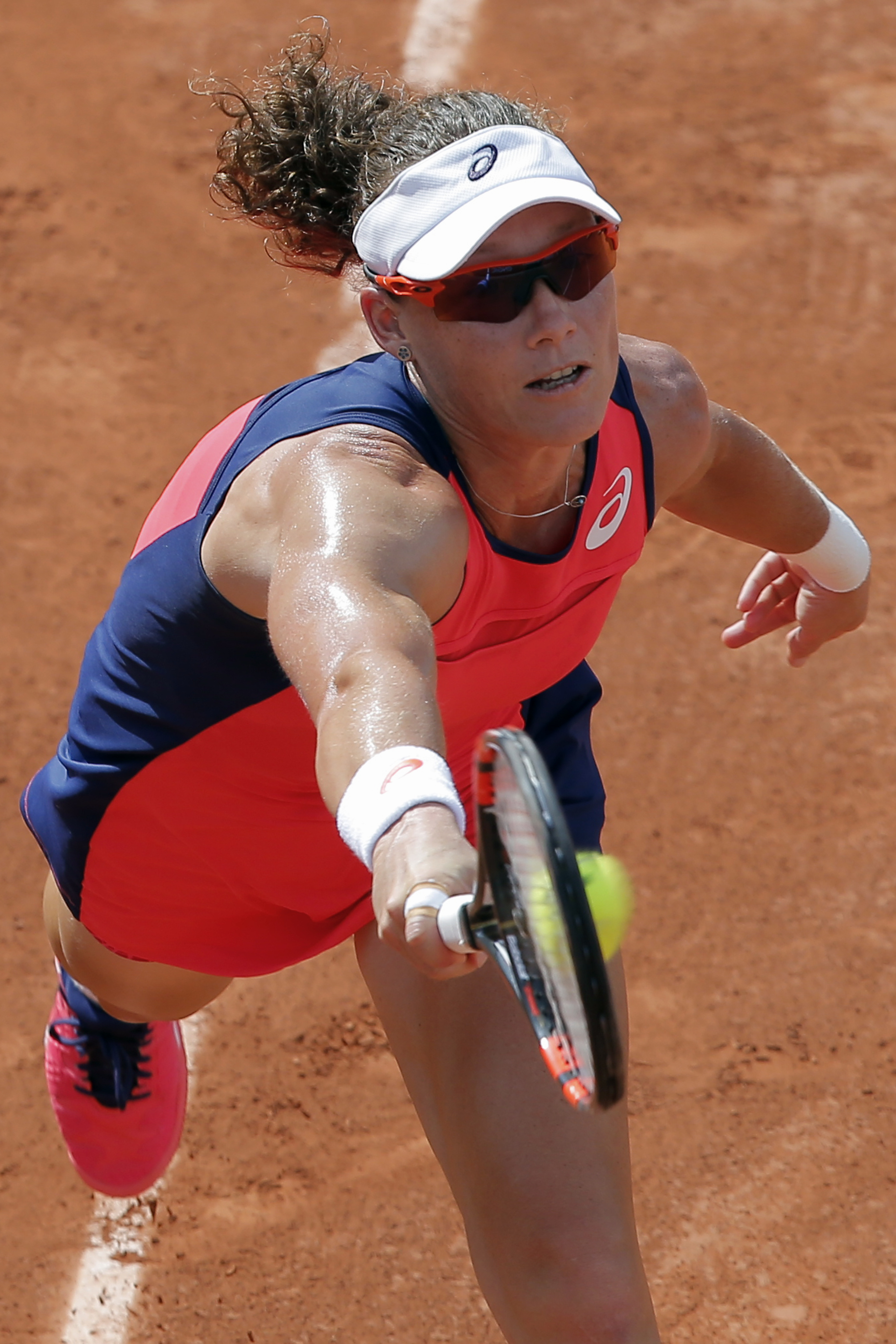 Australia's Samantha Stosur reaches for the ball as she plays Slovakia's Kristina Kucova during their first round match of the French Open tennis tournament at the Roland Garros stadium, Monday, May 29, 2017 in Paris. (AP Photo/Michel Euler)