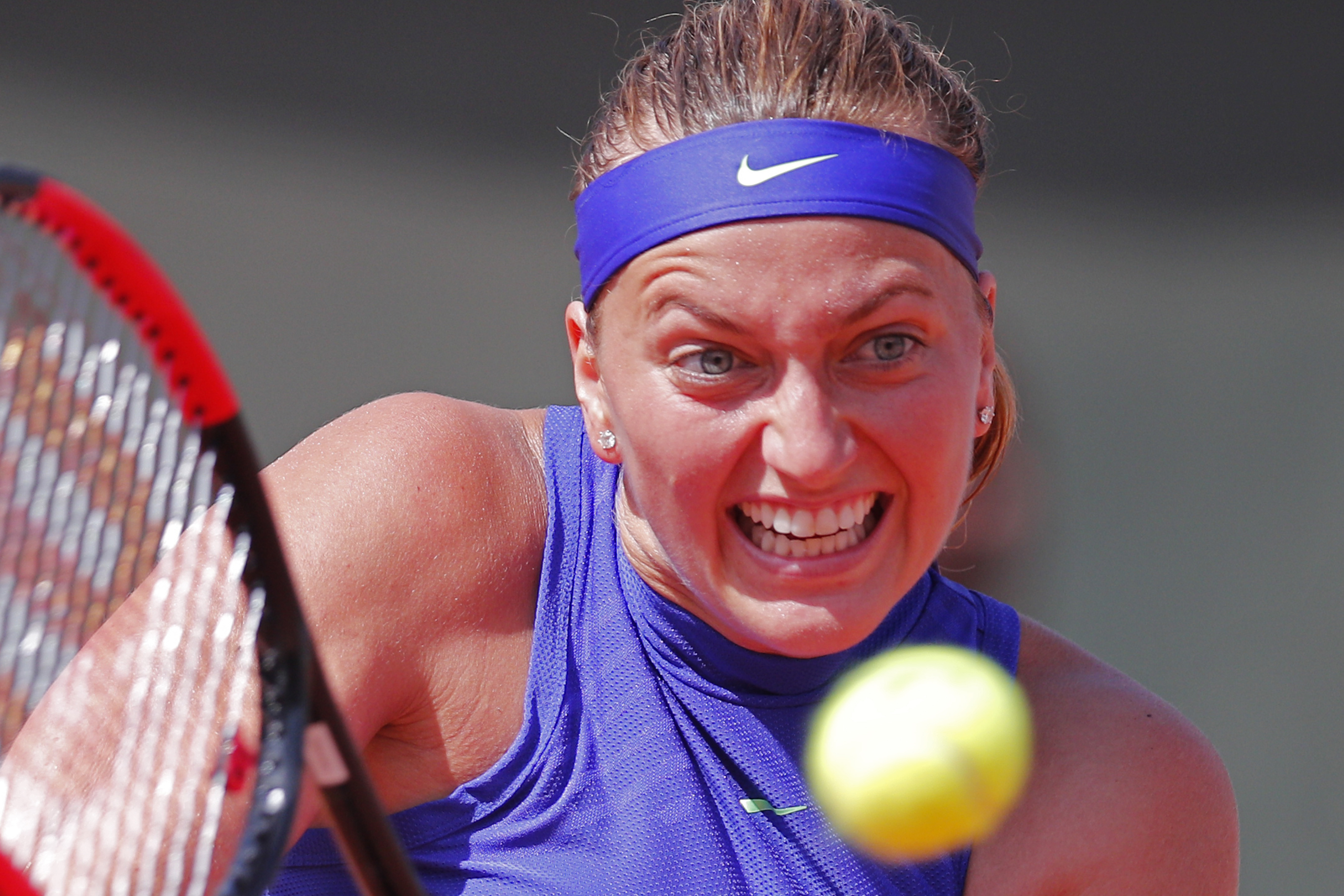 Petra Kvitova of the Czech Republic plays a shot against Bethanie Mattek-Sands of the U.S. during their second round match of the French Open tennis tournament at the Roland Garros stadium, in Paris, France. Wednesday, May 31, 2017. (AP Photo/Christophe E