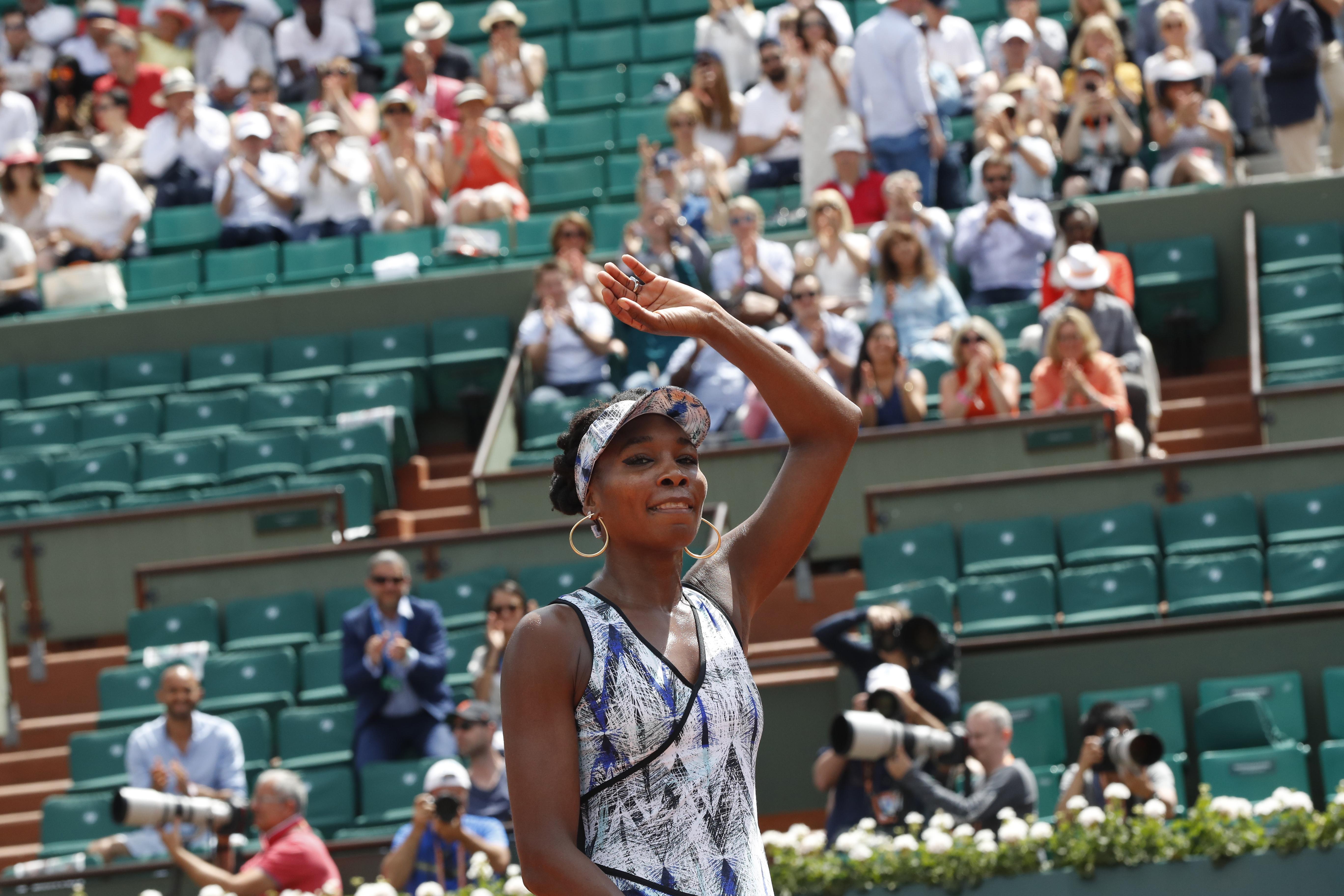 Venus Williams of the U.S. celebrates winning 6-3, 6-1, against Japan's Kurumi Nara during their second round match of the French Open tennis tournament at the Roland Garros stadium, in Paris, France. Wednesday, May 31, 2017. (AP Photo/Petr David Josek)
