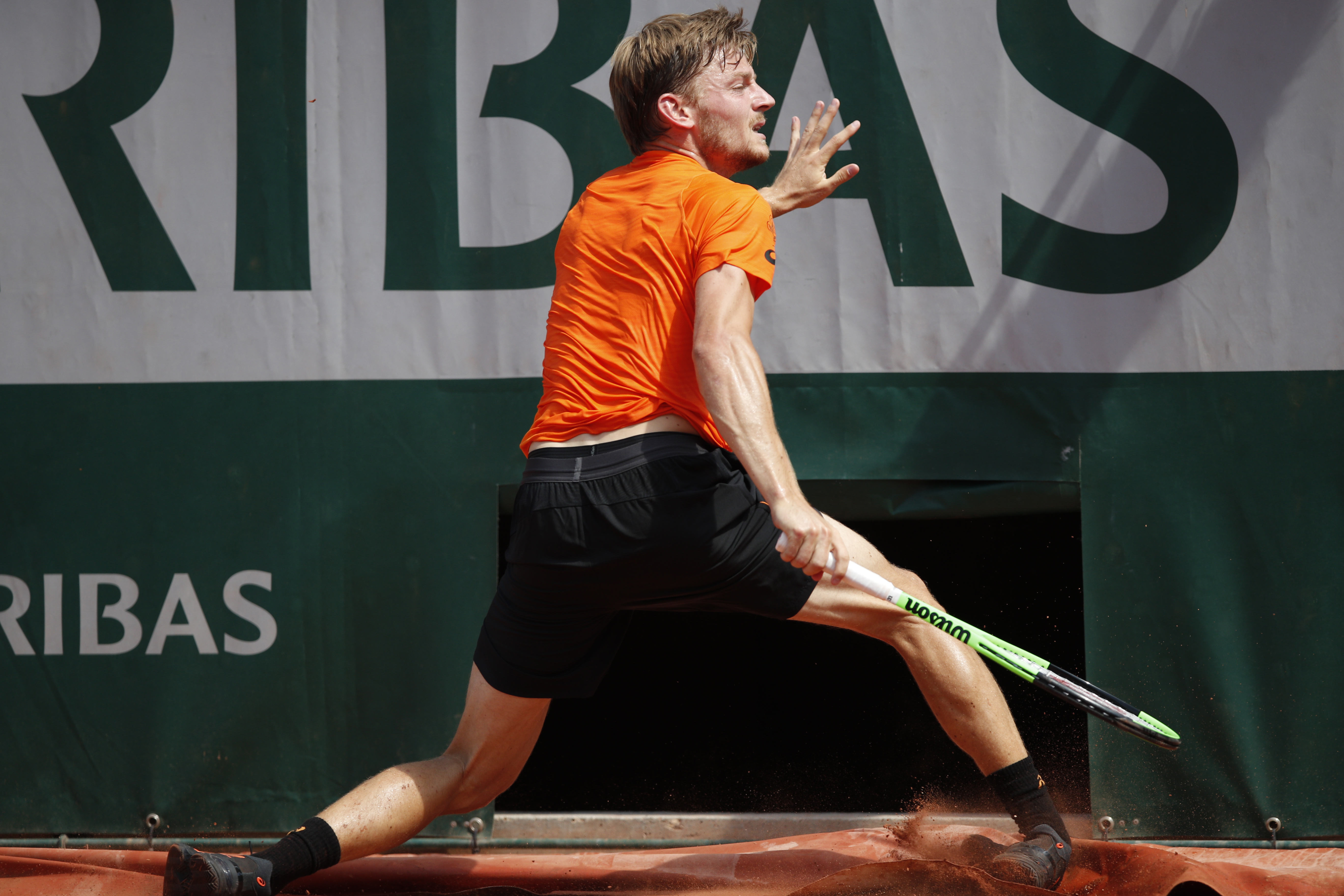 Belgium's David Goffin twists his right ankle in his match against Argentina's Horacio Zeballos during their third round match of the French Open tennis tournament at the Roland Garros stadium, in Paris, France. Friday, June 2, 2017. Goffin's injury force