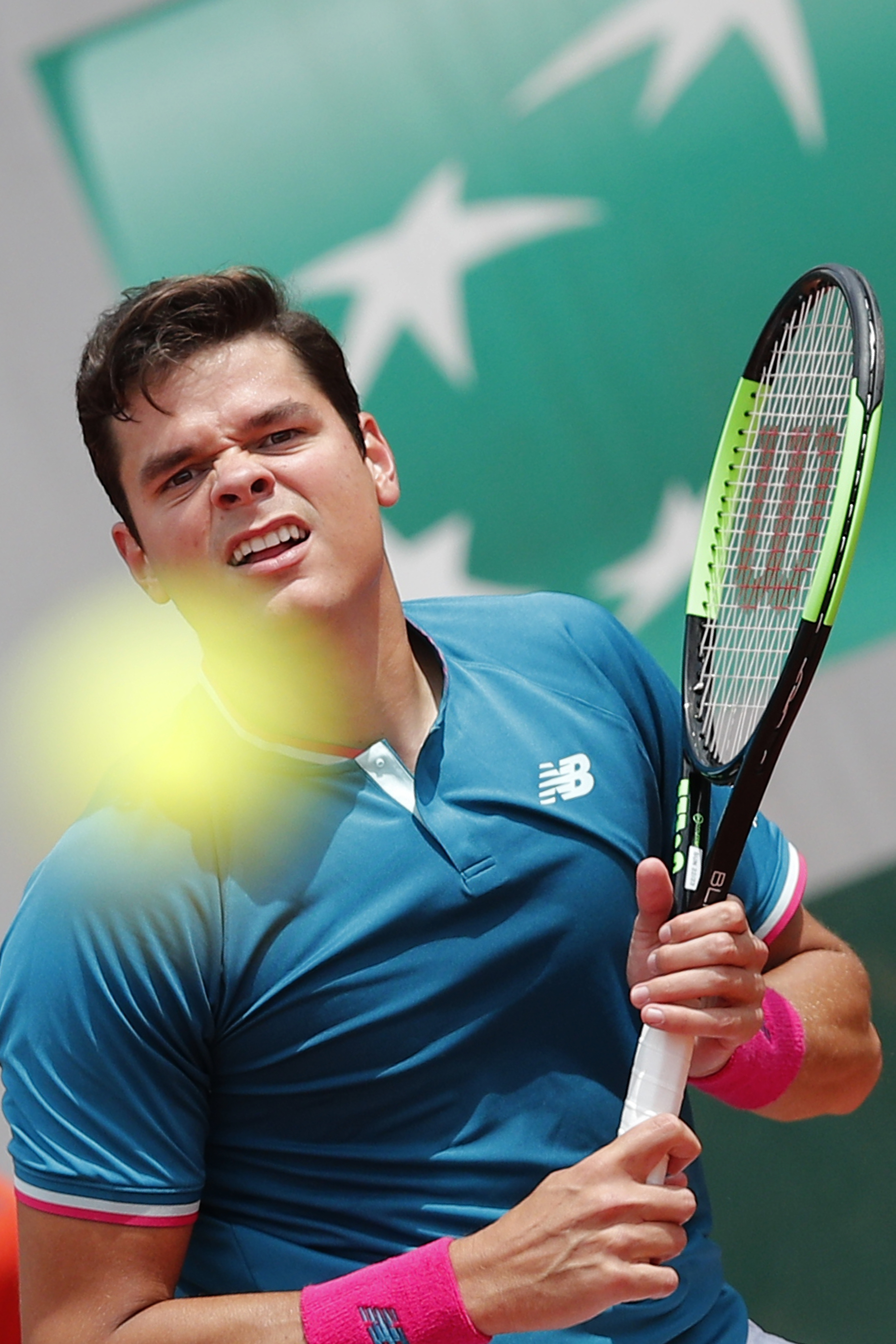 Canada's Milos Raonic follows the ball as he returns against Spain's Pablo Carreno Busta during their fourth round match of the French Open tennis tournament at the Roland Garros stadium, in Paris, France. Sunday, June 4, 2017. (AP Photo/Christophe Ena)