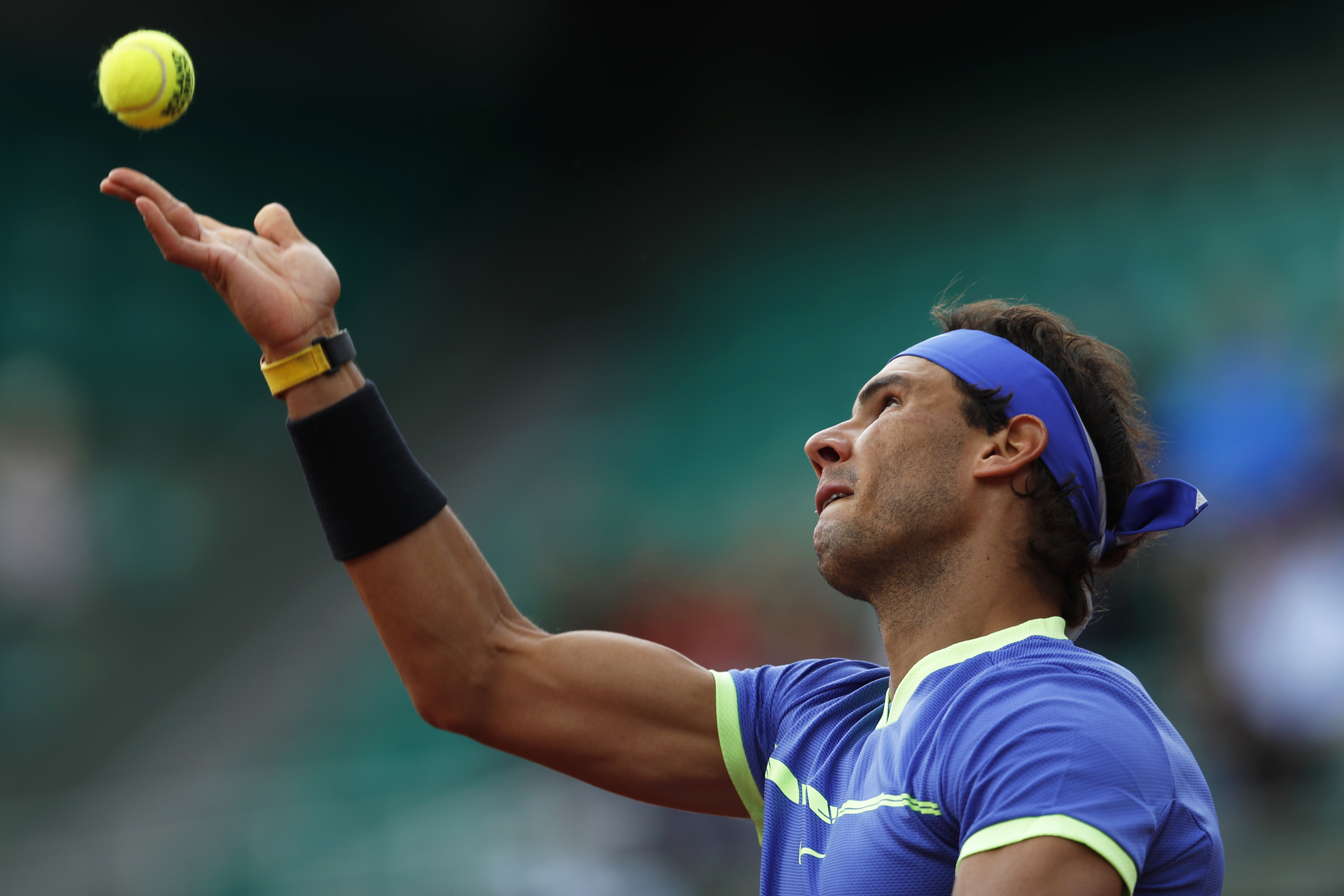 Spain's Rafael Nadal serves against Spain's Pablo Carreno Busta during their quarterfinal match of the French Open tennis tournament at the Roland Garros stadium, in Paris, France. Wednesday, June 7, 2017. (AP Photo/Petr David Josek)
