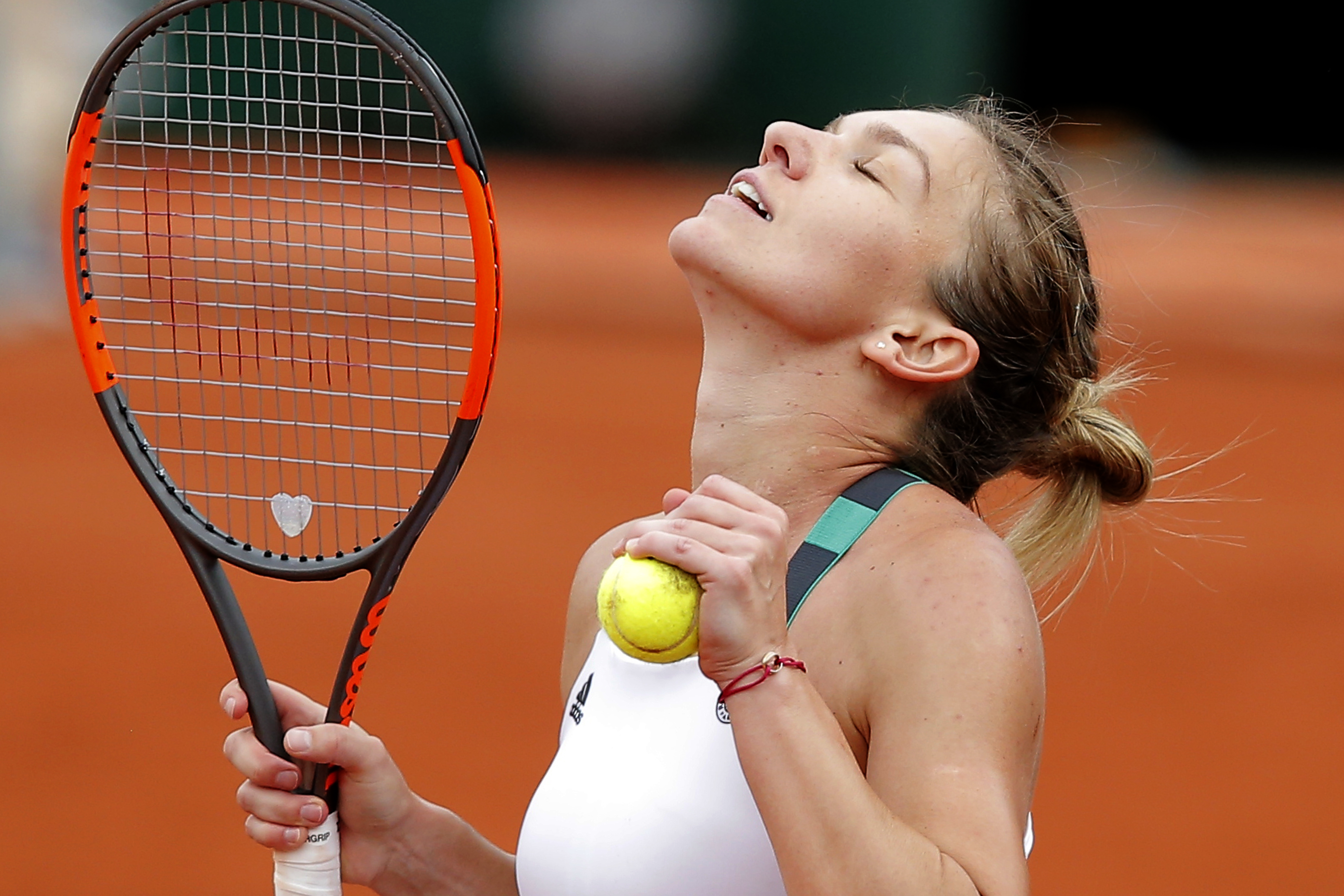 Romania's Simona Halep reacts as she defeats Karolina Pliskova of the Czech Republic during their semifinal match of the French Open tennis tournament at the Roland Garros stadium, Thursday, June 8, 2017 in Paris. (AP Photo/Michel Euler)