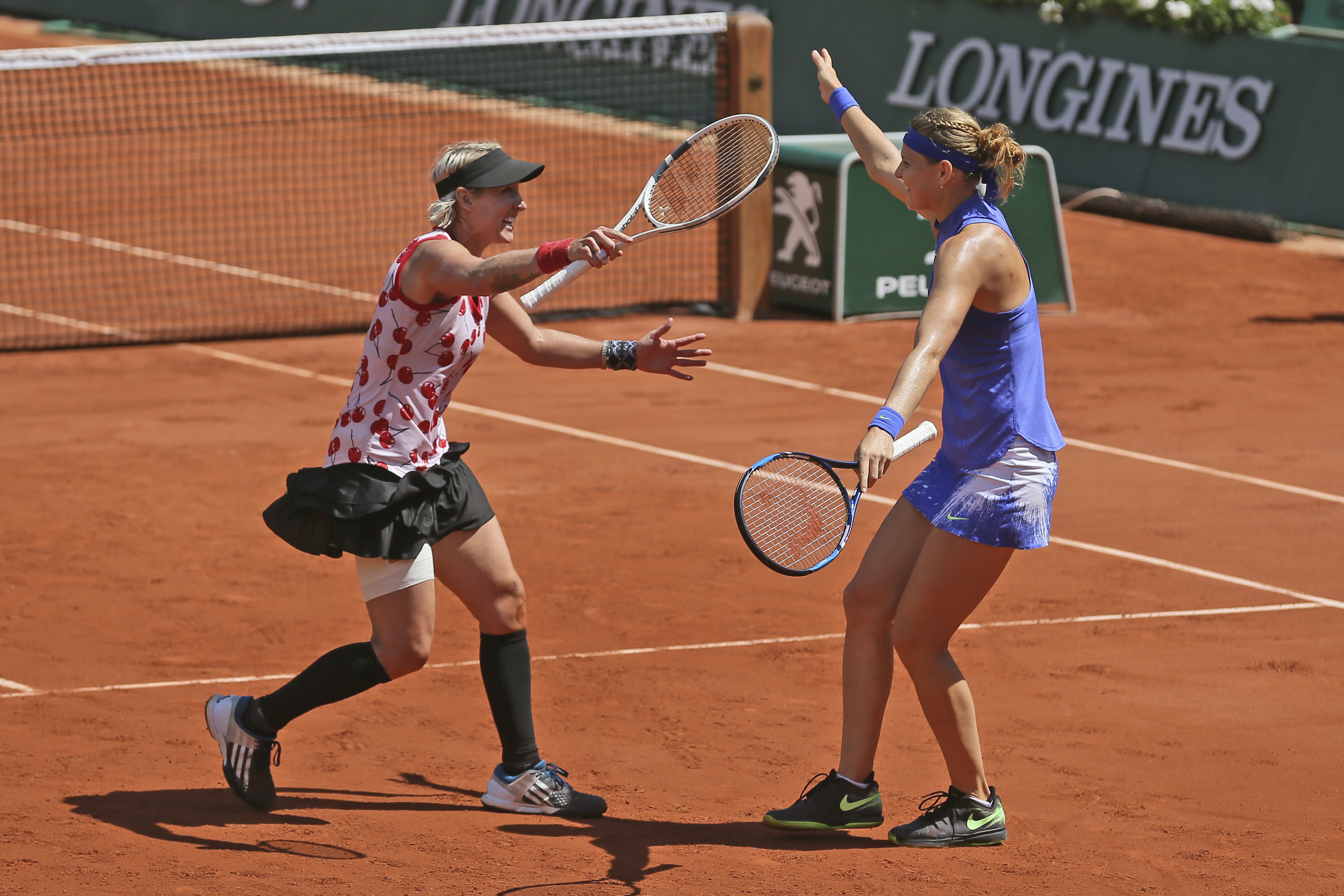 Bethanie Mattek-Sands of the U.S., left, and Lucie Safarova of the Czech Republic celebrate winning women's doubles final match against Australia's Ashleigh Barty and Casey Dellacqua in two sets 6-2, 6-1, at the French Open tennis tournament at the Roland