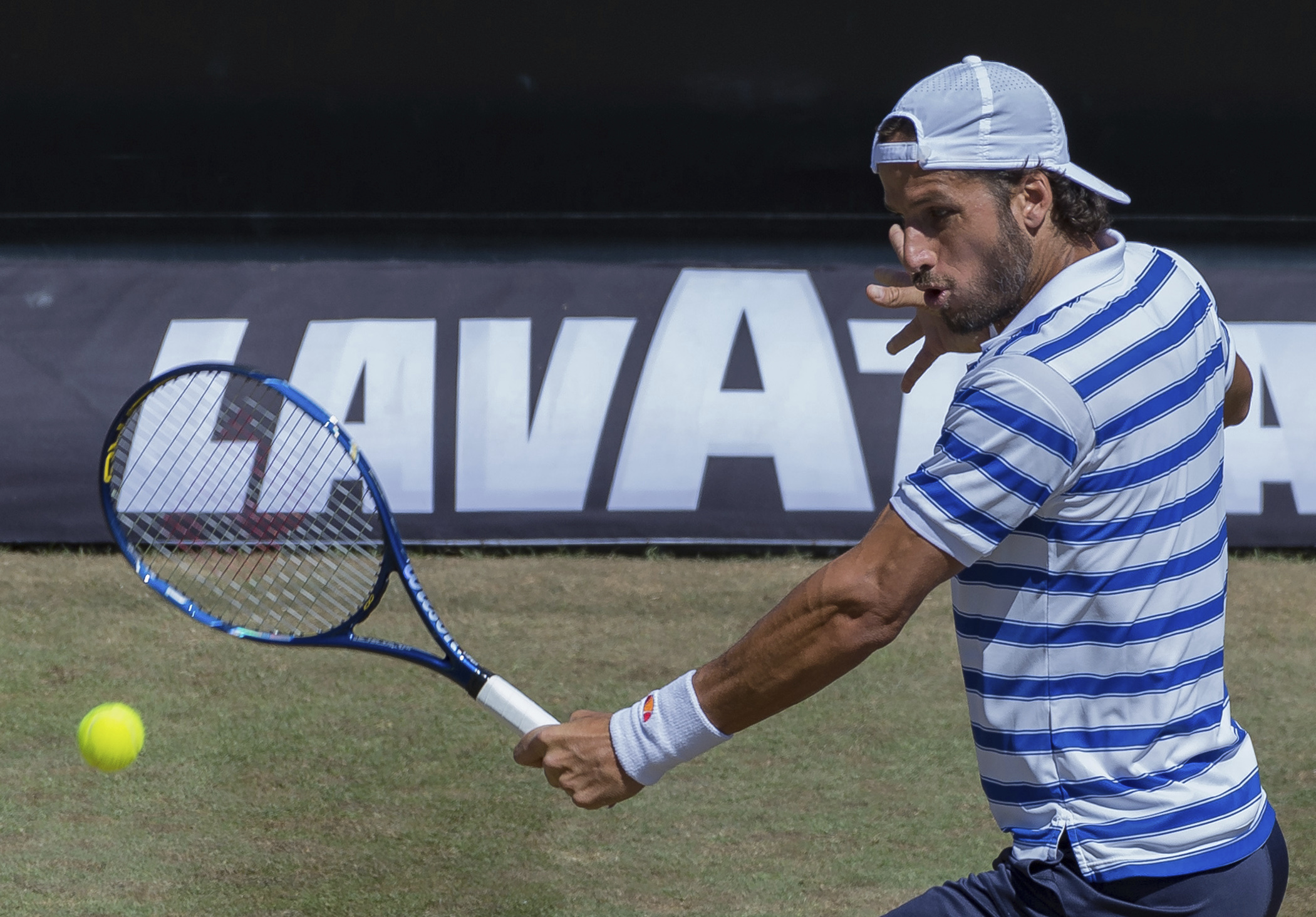 Spain's Feliciano Lopez returns the ball to Czech Republic's Tomas Berdych during their quarterfinal match at the Mercedes Cup tennis tournament in Stuttgart, Germany Friday, June 16, 2017. (Daniel Maurer/dpa via AP)
