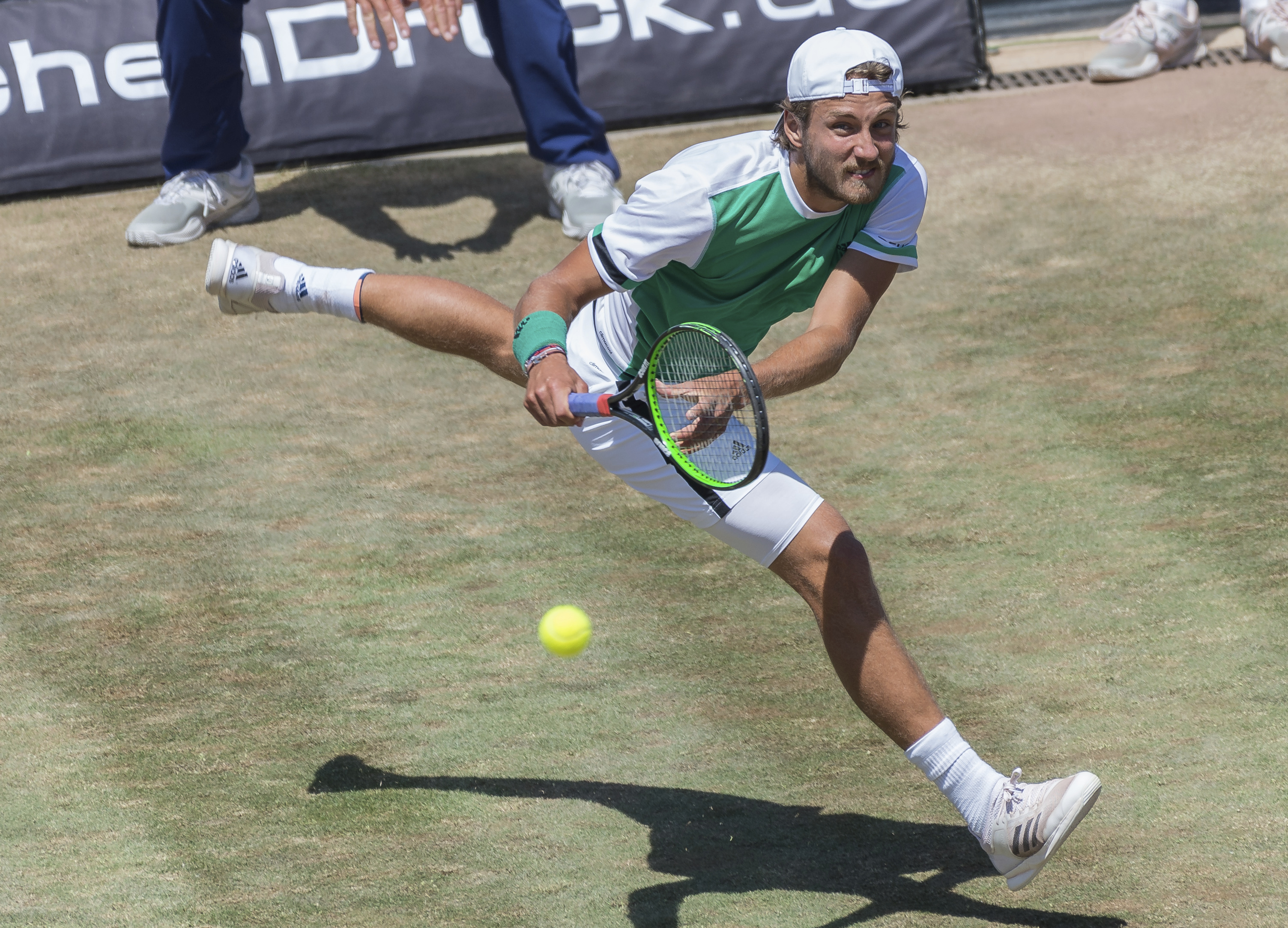 Lucas Pouille from France returns a ball to Feliciano Lopez from Spain during the final of the ATP tennis tournament in Stuttgart, southern Germany, Sunday, June 18, 2017. (Daniel Maurer/dpa via AP)