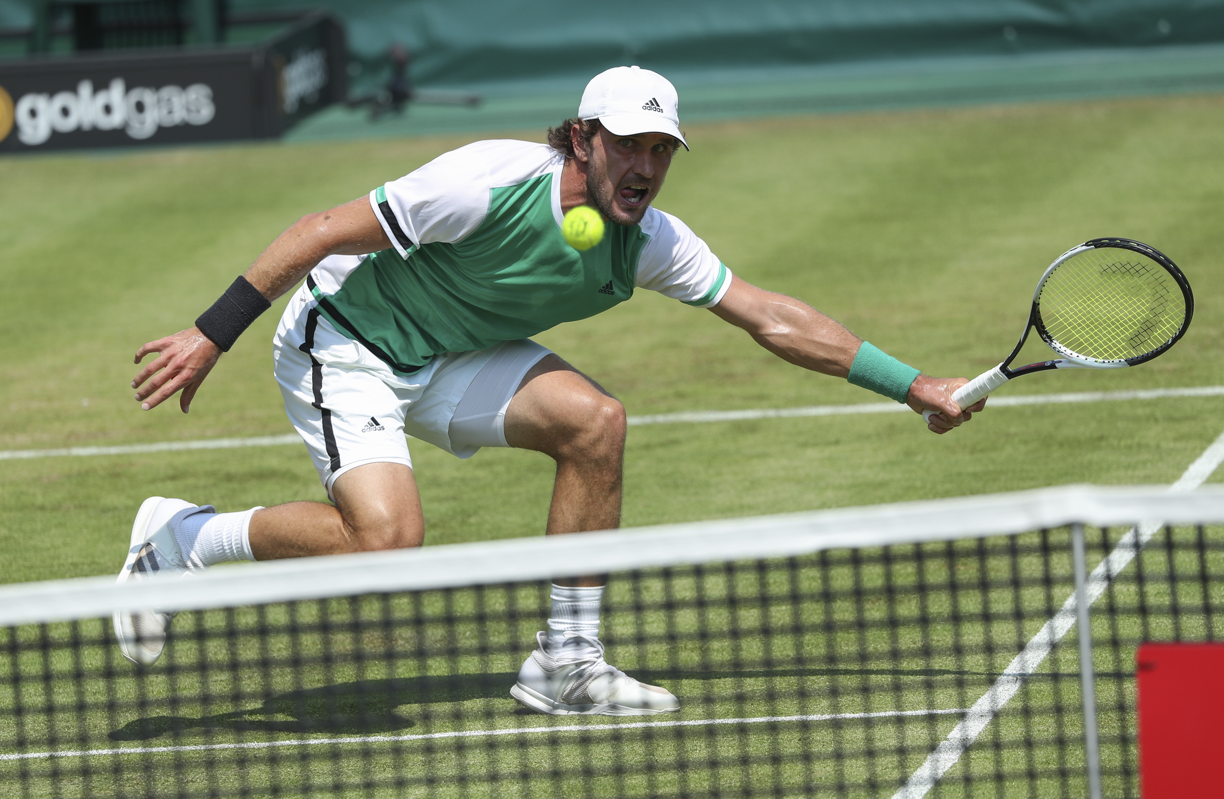 Germany's Mischa Zverev  returns a shot to Slovakia's  Lukas Lacko at the Gerry Weber Open ATP tennis tournament in Halle, Germany, Tuesday, June 20, 2017.  (Friso Gentsch/dpa via AP)