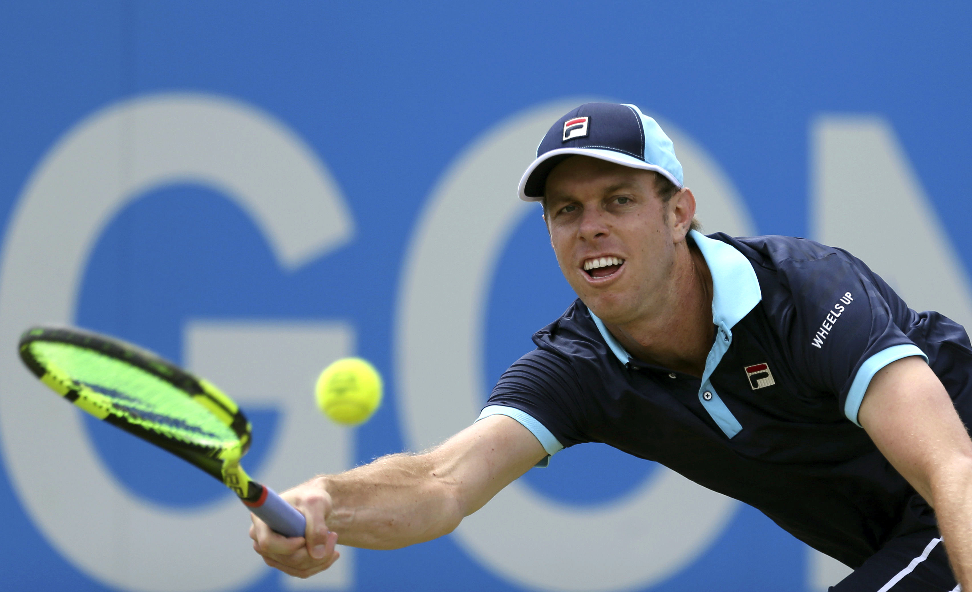 Sam Querrey of the United States returns a ball,  during his match against Luxembourg's Gilles Muller, on day five of the Queen's Club tennis tournament in London, Friday June 23, 2017. (Steven Paston/PA via AP)