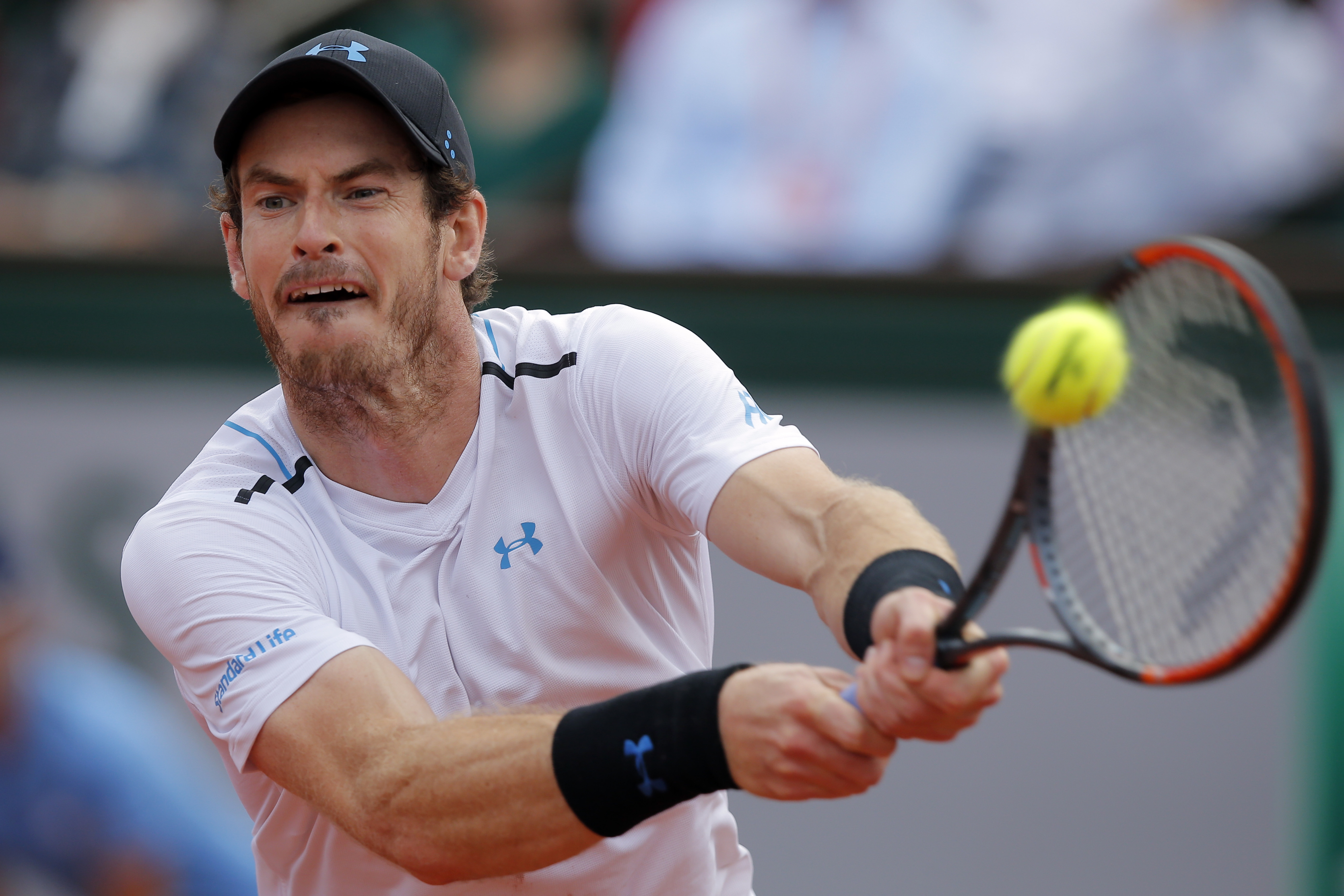 FILE - In this file photo dated Friday, June 9, 2017, Britain's Andy Murray in action against Switzerland's Stan Wawrinka during their semifinal match of the French Open tennis tournament at the Roland Garros stadium, in Paris.  Britain's top ranked Andy