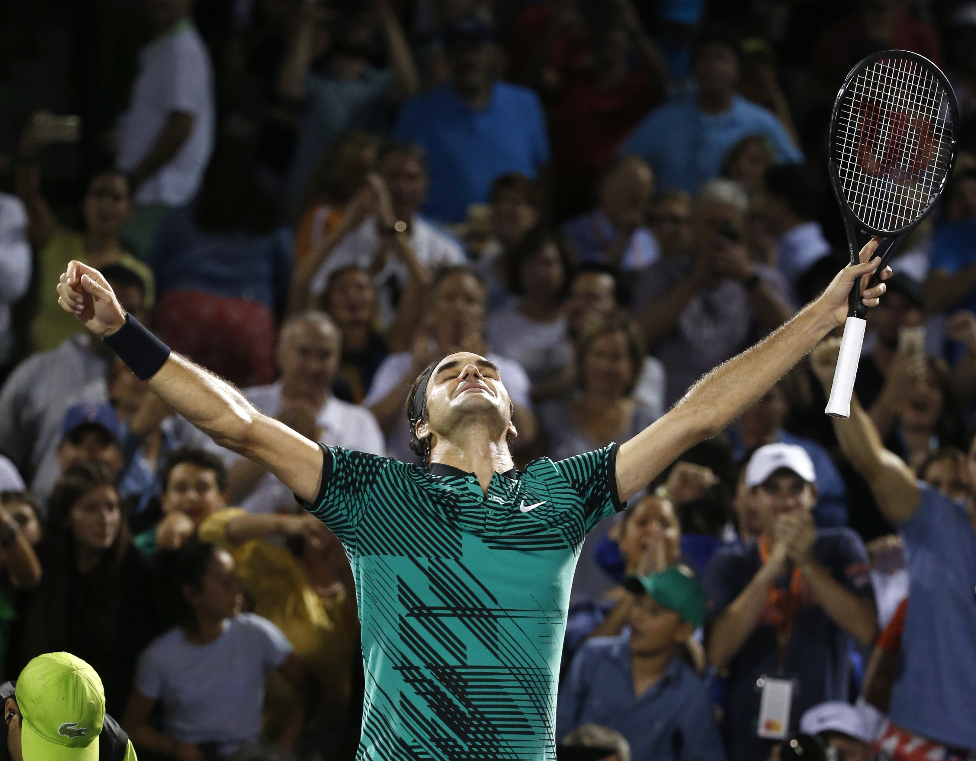 FILE - In this March 31, 2017, file photo, Roger Federer, of Switzerland, celebrates after defeating Nick Kyrgios, of Australia, in a tennis match at the Miami Open, in Key Biscayne, Fla. Federer extended his record with an 18th major championship in Aust