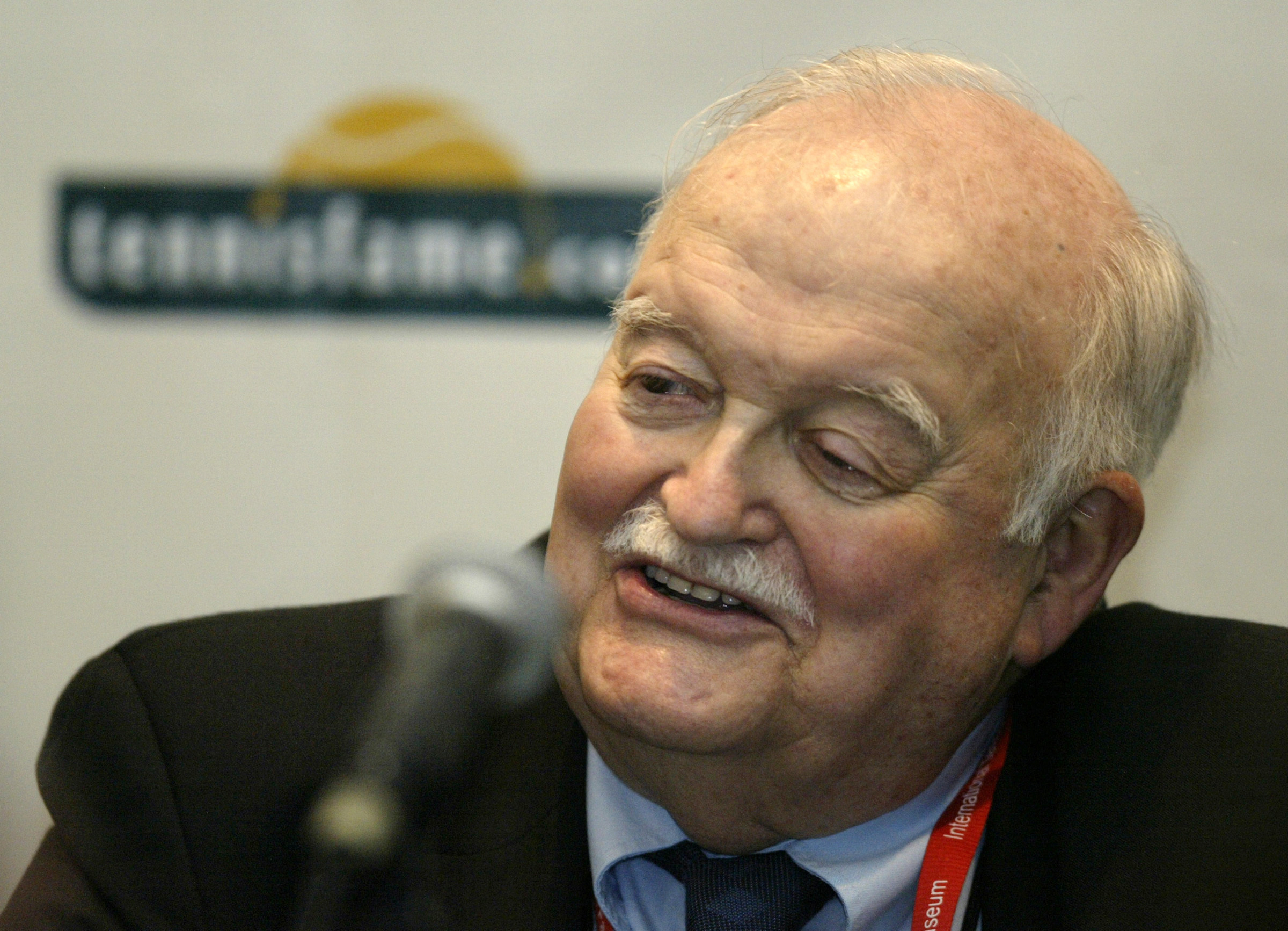 FILE - In this July 14, 2007, file photo, photographer Russ Adams talks during a news conference prior to his induction into the International Tennis Hall of Fame in Newport, R.I. The acclaimed tennis photographer has died Friday, June 30, 2017, after chr