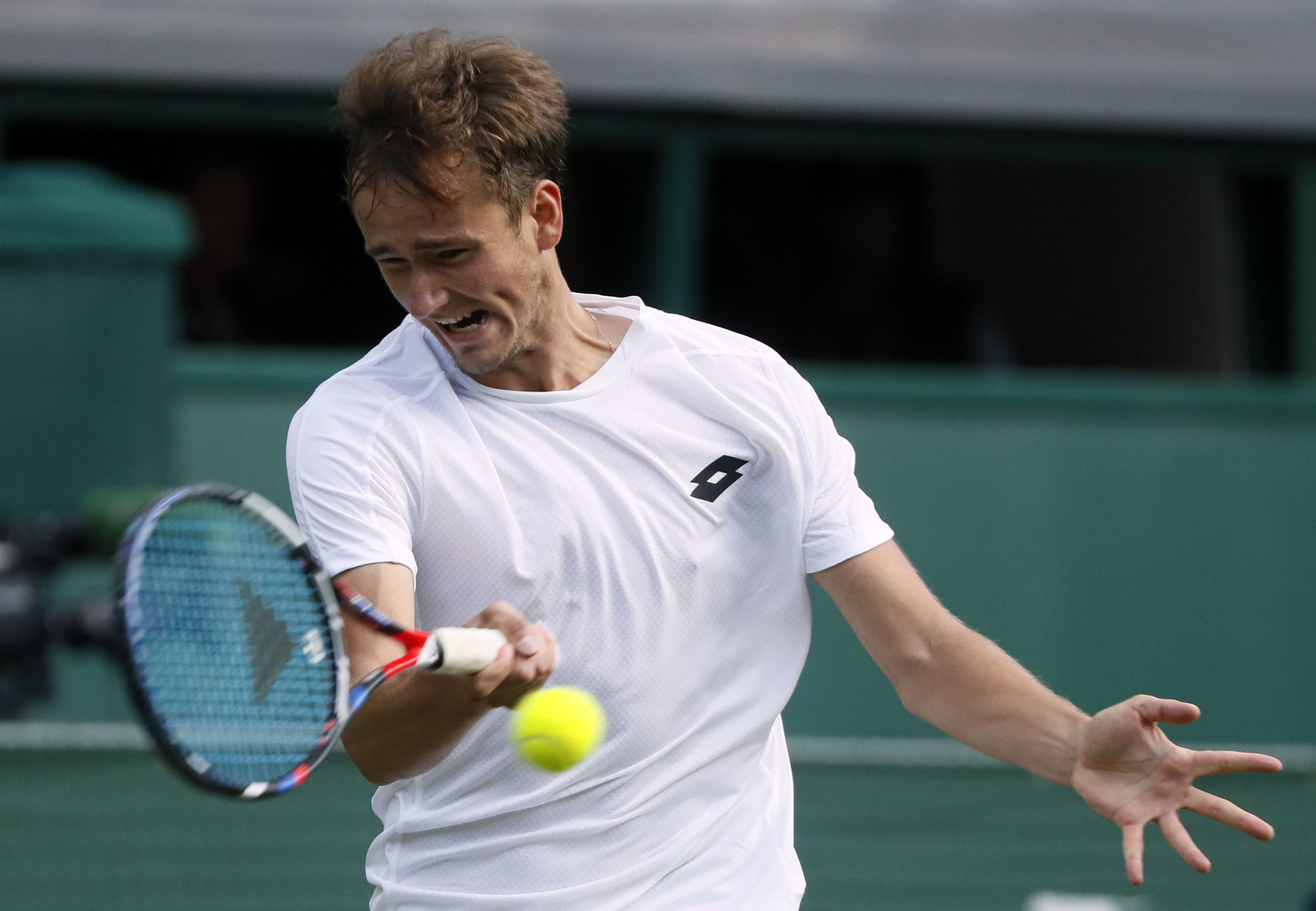 Russia's Daniil Medvedev returns to Switzerland's Stan Wawrinka during his Men's Singles Match on the opening day at the Wimbledon Tennis Championships in London Monday, July 3, 2017. (AP Photo/Kirsty Wigglesworth)