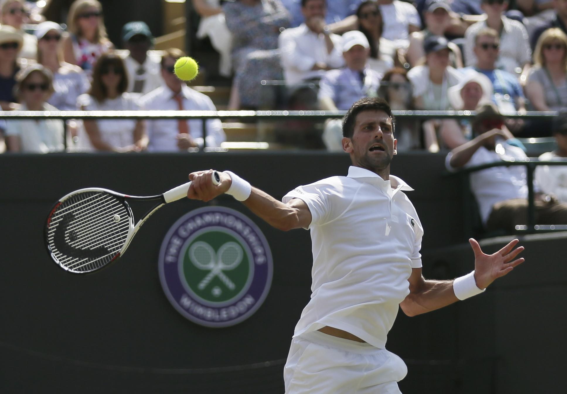 Serbia's Novak Djokovic plays against Czech Republic's Adam Pavlasek during their Men's Singles Match on day four at the Wimbledon Tennis Championships in London Thursday, July 6, 2017. (AP Photo/Tim Ireland)