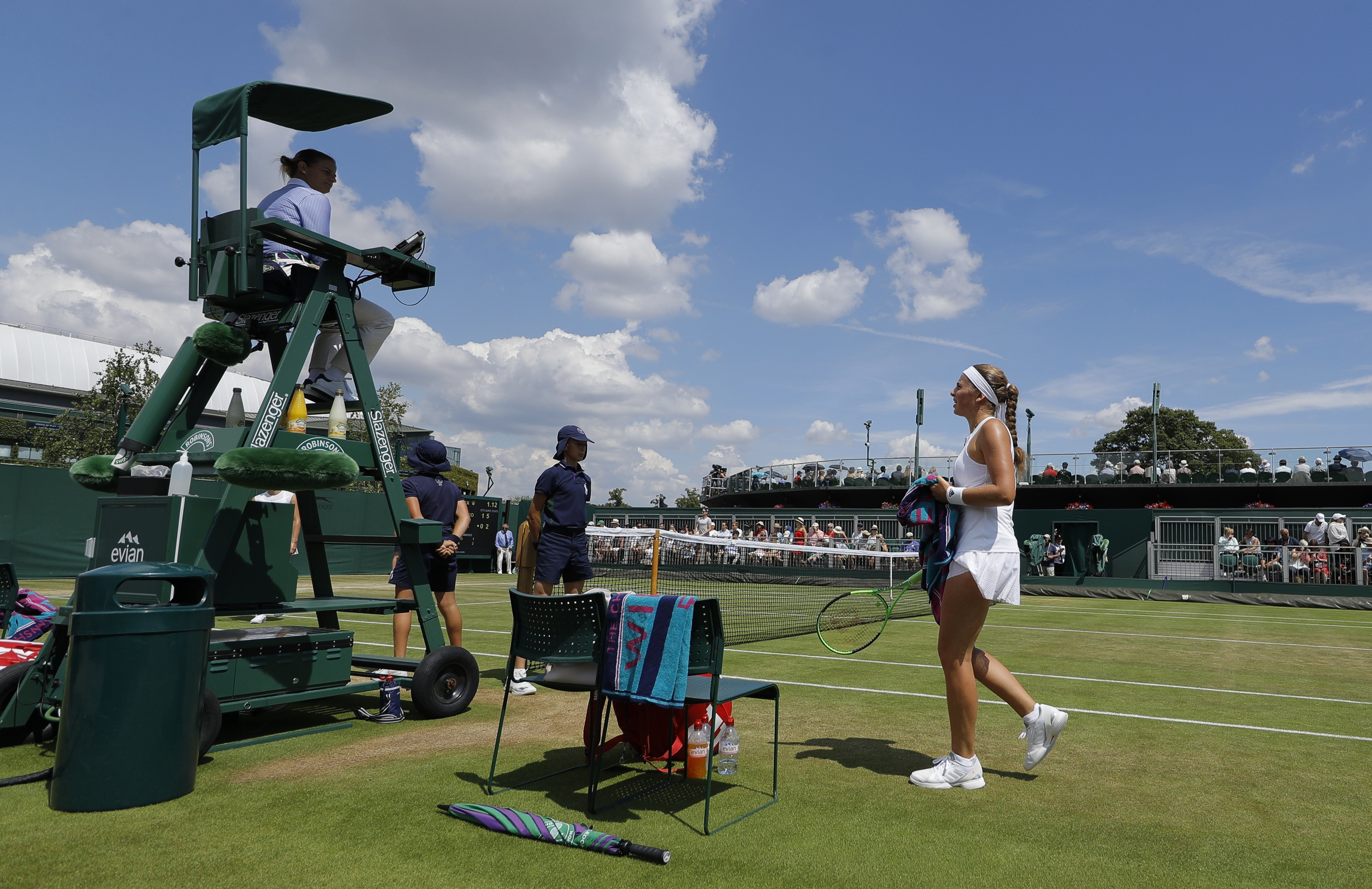 Latvia's Jelena Ostapenko returns to her seat during a change of ends break in her Women's Singles Match against Ukraine's Elina Svitolina on day seven at the Wimbledon Tennis Championships in London Monday, July 10, 2017. (AP Photo/Alastair Grant)