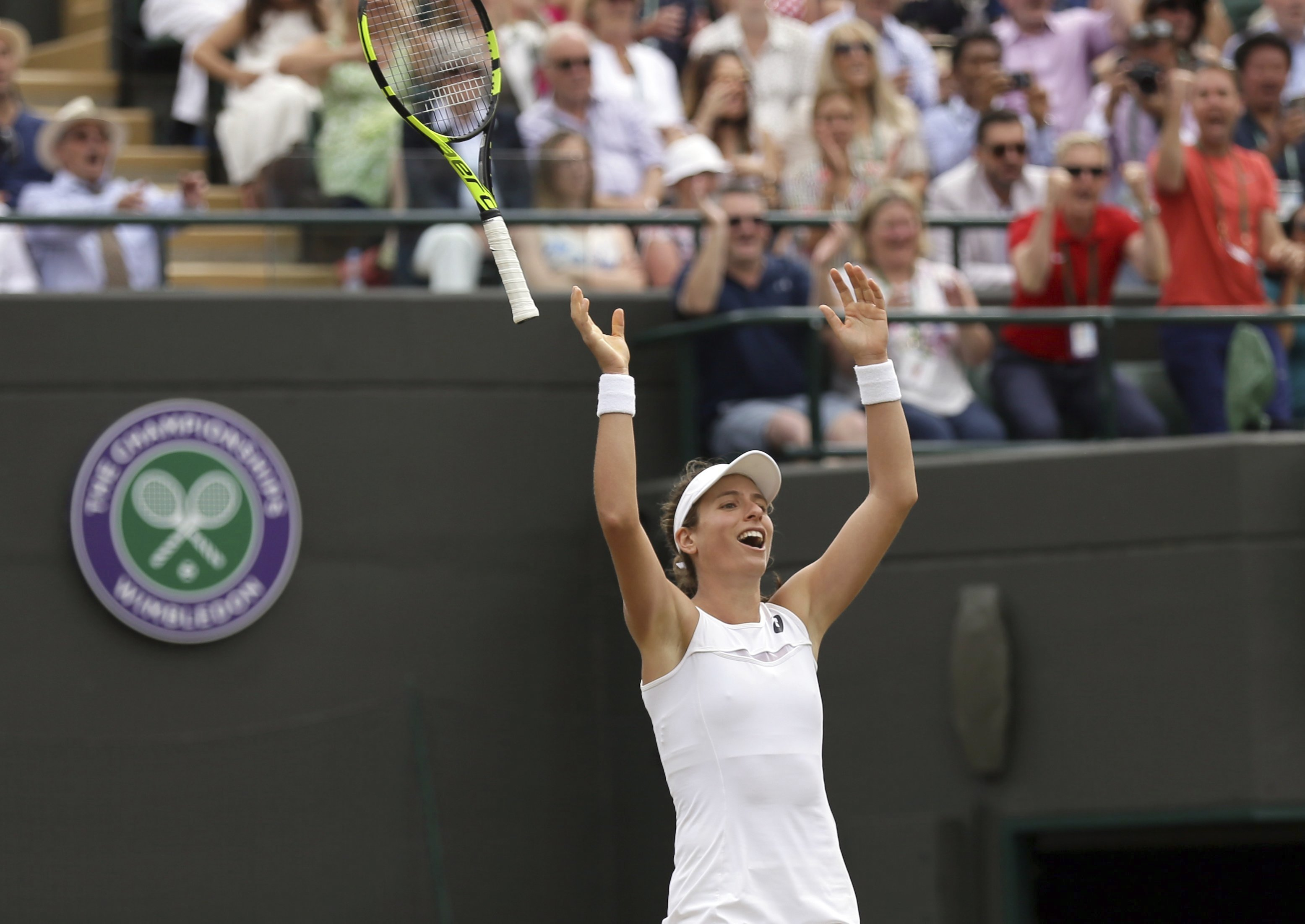 Britain's Johanna Konta celebrates after beating Caroline Garcia of France in their Women's Singles Match on day seven at the Wimbledon Tennis Championships in London Monday, July 10, 2017. (AP Photo/Tim Ireland)