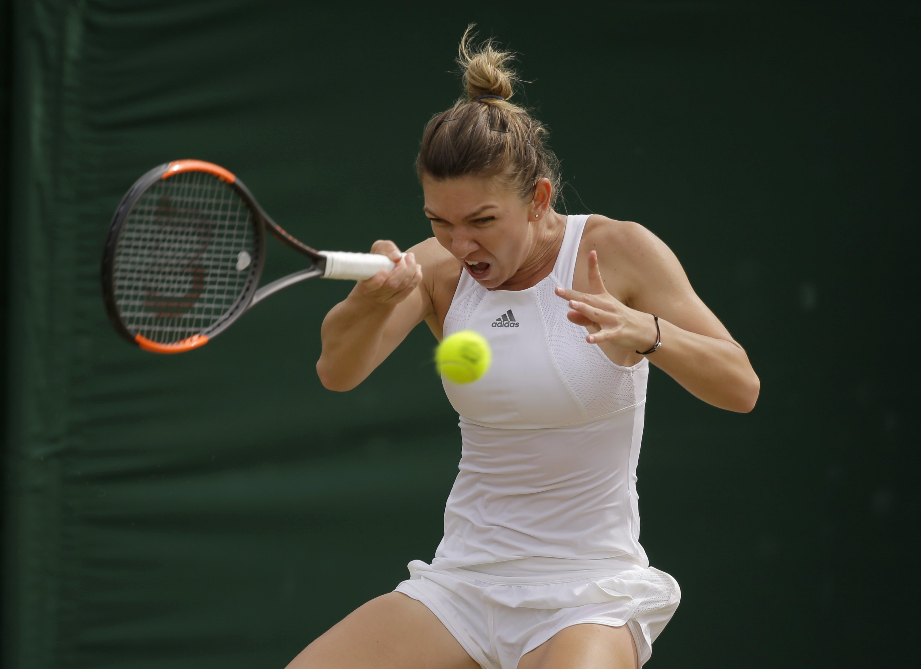 Romania's Simona Halep returns to Victoria Azarenka of Belarus during their Women's Singles Match on day seven at the Wimbledon Tennis Championships in London Monday, July 10, 2017. (AP Photo/Alastair Grant)