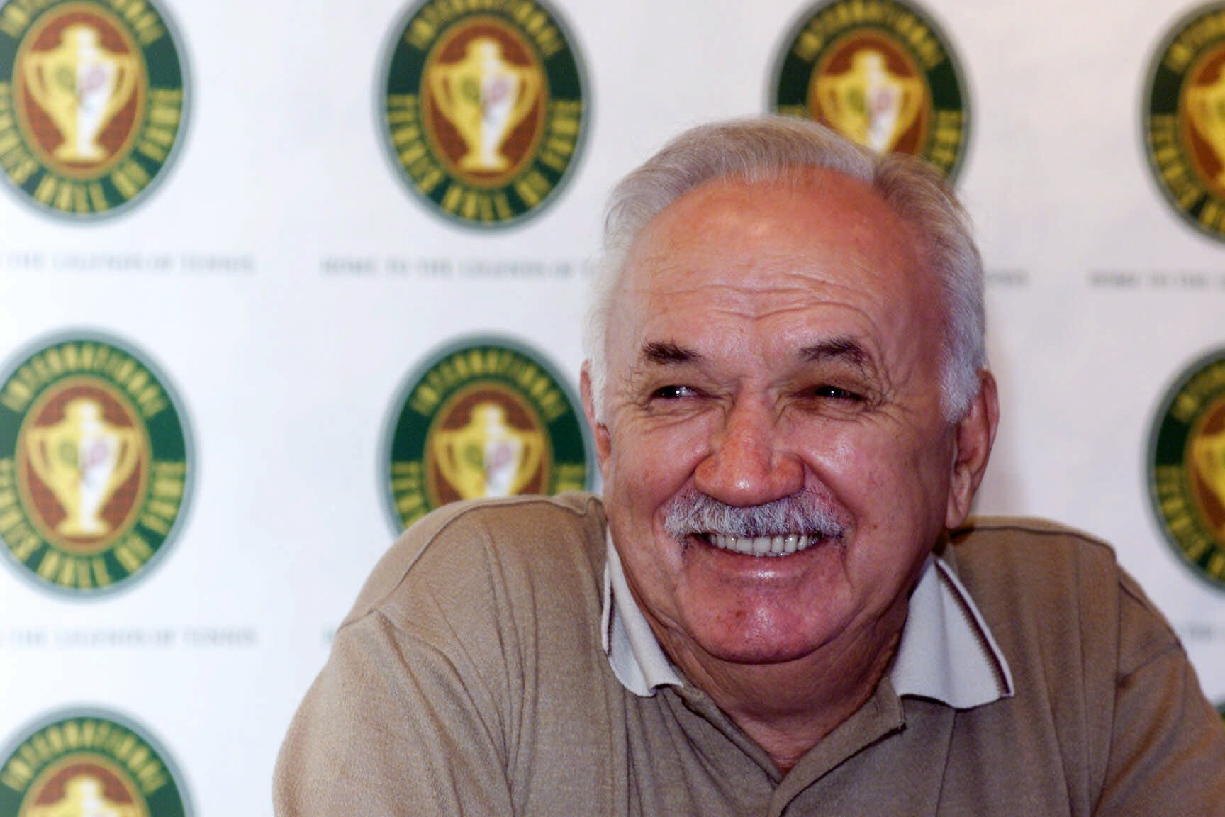 Mervyn Rose smiles during a news conference at the Newport Tennis Hall of Fame, prior to being inducted, Saturday, July 14, 2001 in Newport, R.I. (AP Photo/Victoria Arocho)