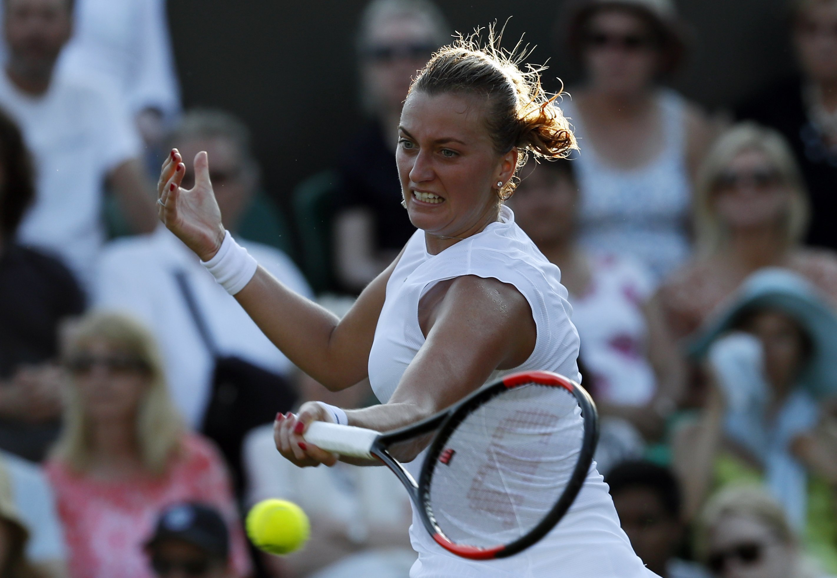 Czech Republic's Petra Kvitova returns to Madison Brengle of the United States during their Women's Single Match on day three at the Wimbledon Tennis Championships in London Wednesday, July 5, 2017. (AP Photo/Kirsty Wigglesworth)