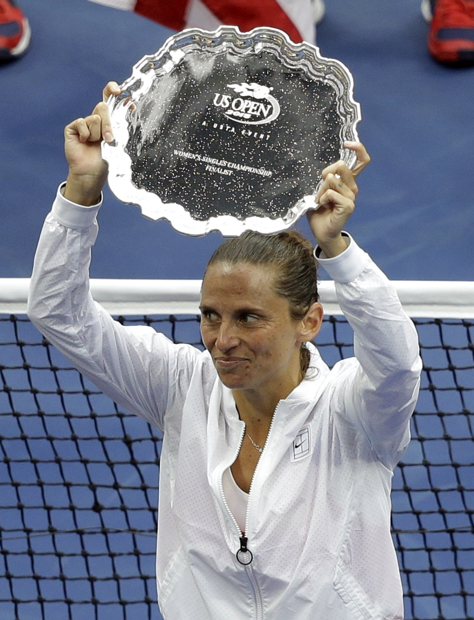 FILE - In this  Saturday, Sept. 12, 2015 file photo Roberta Vinci, of Italy, holds the finalist's trophy after she was beaten by Flavia Pennetta, of Italy, in the women's championship match of the U.S. Open tennis tournament, in New York. Former U.S. Open