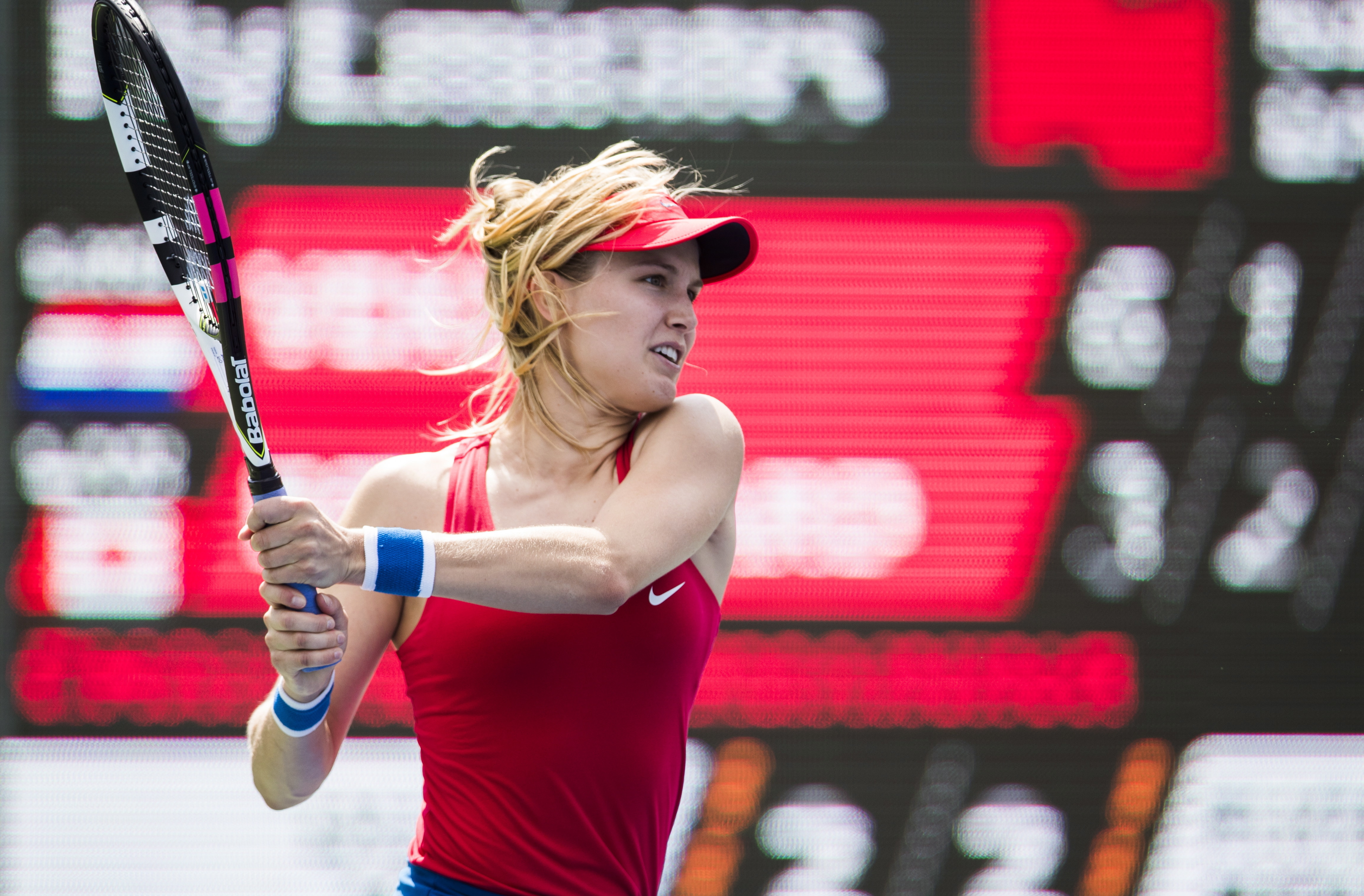 Eugenie Bouchard, of Canada, returns a shot to Donna Vekic, of Croatia, during their first-round match at the Rogers Cup WTA women's tennis tournament in Toronto, Tuesday, Aug. 8, 2017. (Mark Blinch/The Canadian Press via AP)