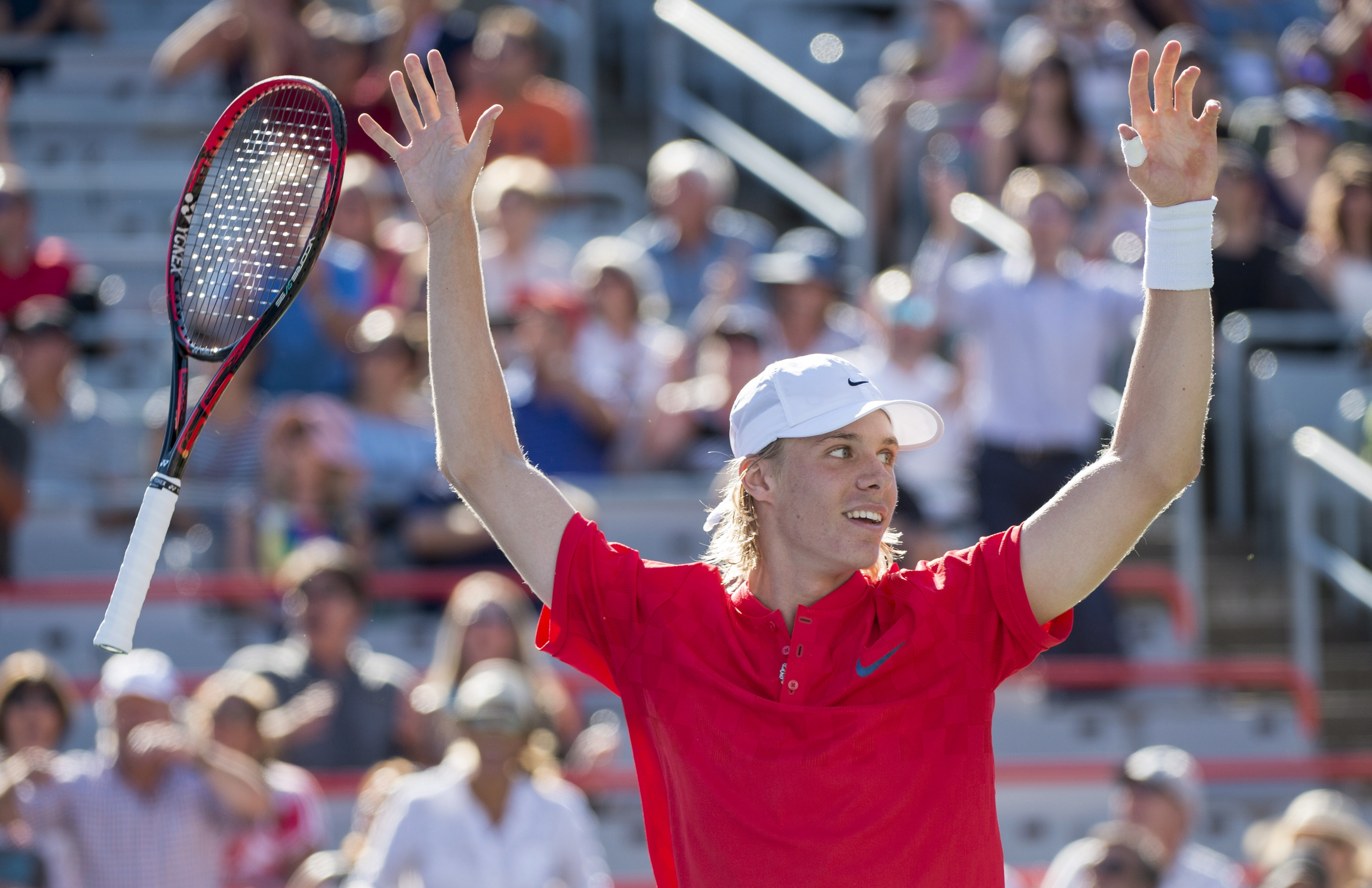 Denis Shapovalov of Canada celebrates after beating Rogerio Dutra Silva of Brazil during the first round of the Rogers Cup tennis tournament, Tuesday Aug. 8, 2017 in Montreal. (Paul Chiasson/The Canadian Press via AP)