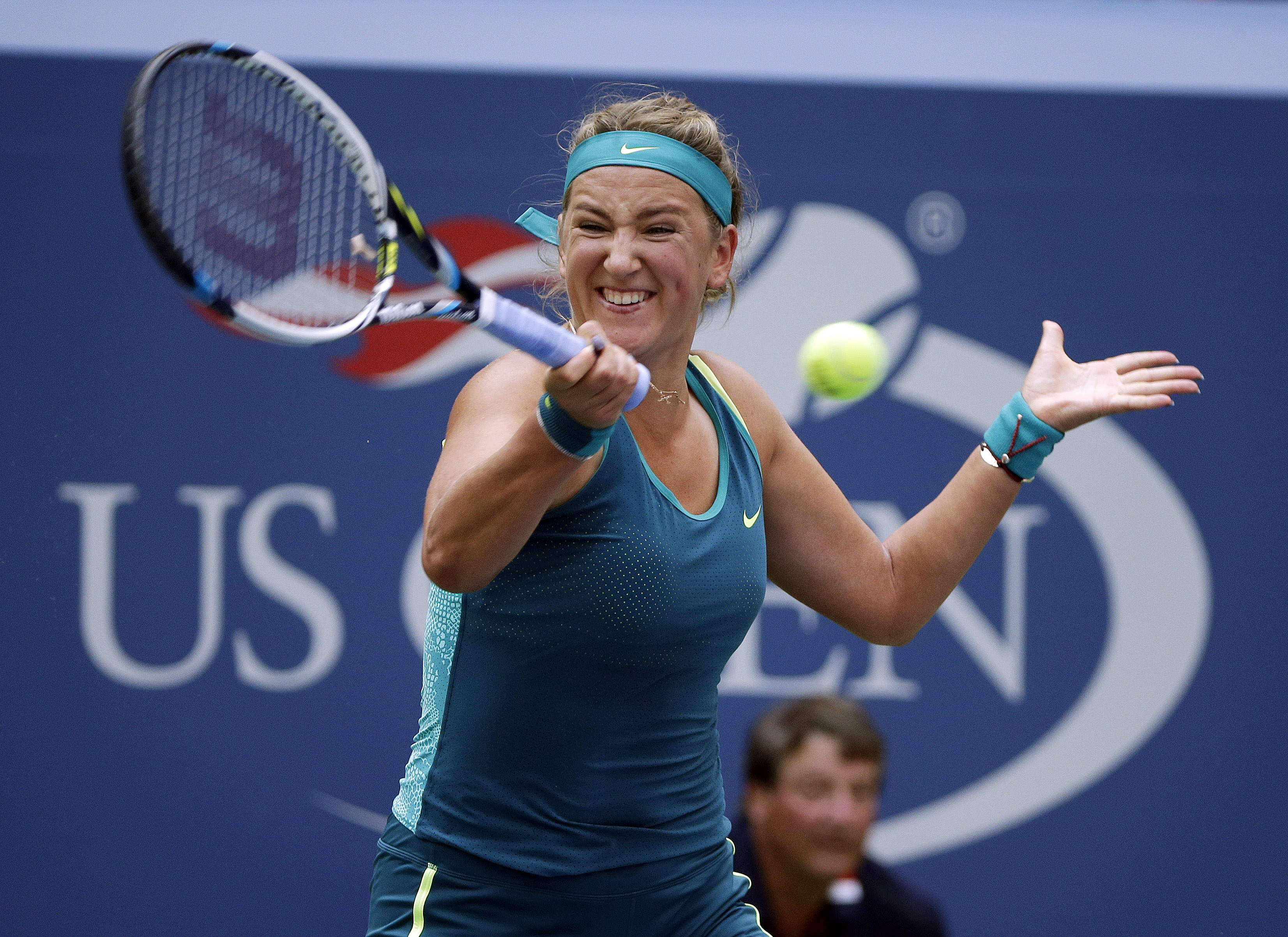 FILE - In this Sept. 3, 2015, file photo, Victoria Azarenka, of Belarus, returns a shot to Yanina Wickmayer, of Belgium, during the second round of the U.S. Open tennis tournament, in New York. Two-time Australian Open champion Victoria Azarenka says her