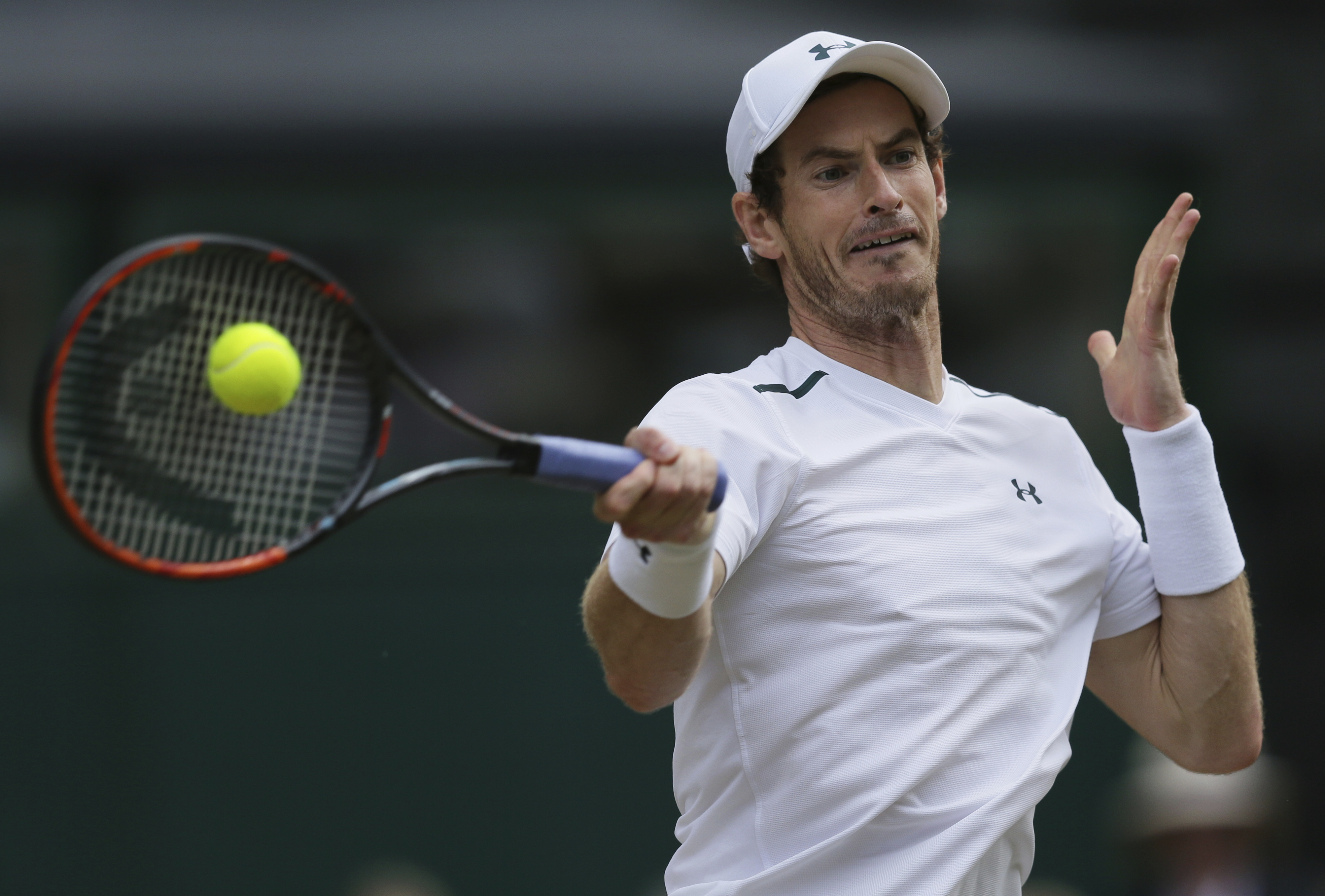 File-This July 12, 2017, file photo shows Britain's Andy Murray returning to Sam Querrey of the United States during their Men's Singles Quarterfinal Match at the Wimbledon Tennis Championships in London. (AP Photo/Tim Ireland, File)