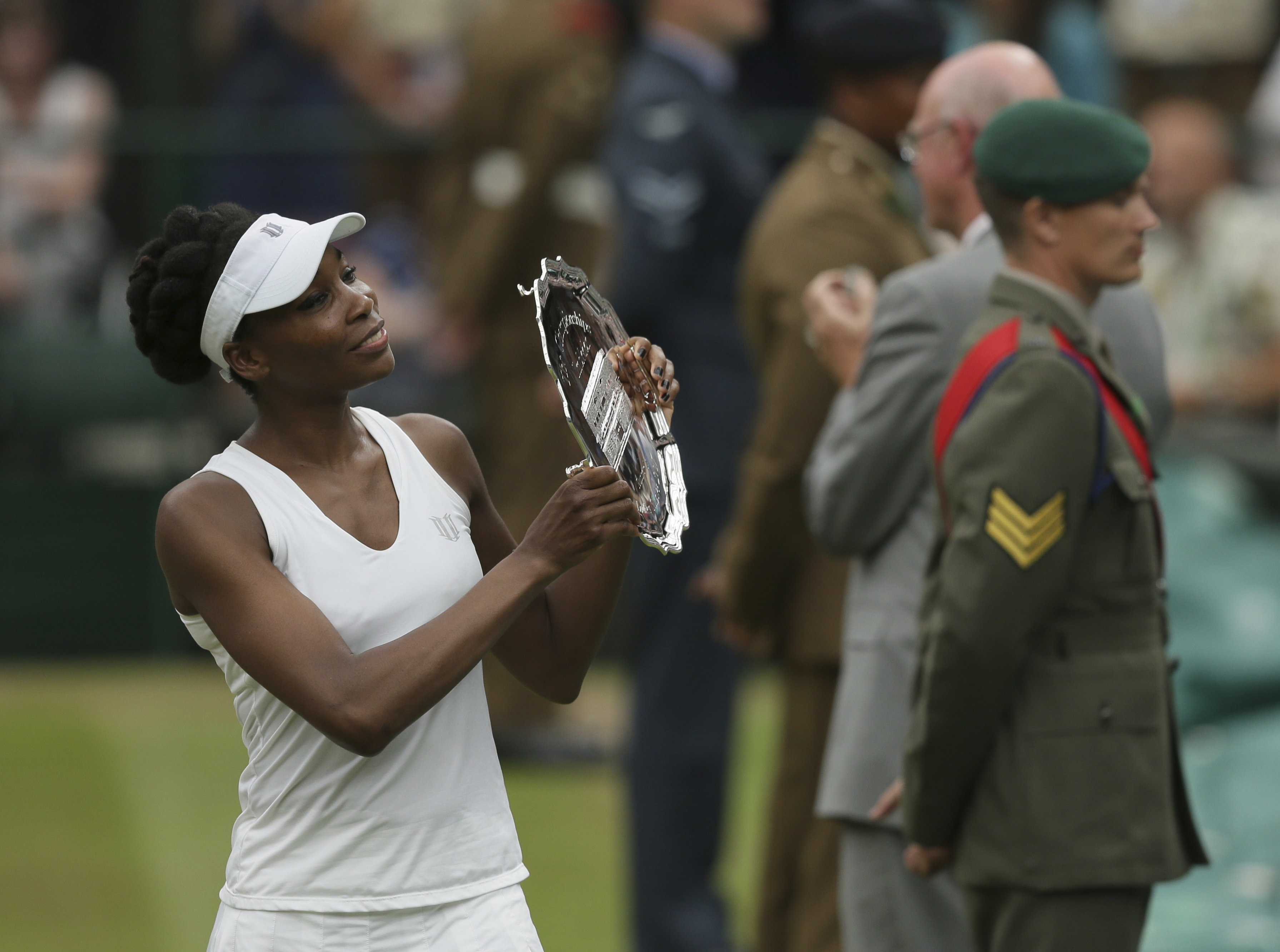 File-This July 15, 2017, file photo shows Venus Williams of the United States holding the runners-up plate after losing to Spain's Garbine Muguruza in the Women's Singles final match at the Wimbledon Tennis Championships in London.  Andy Roddick was the l