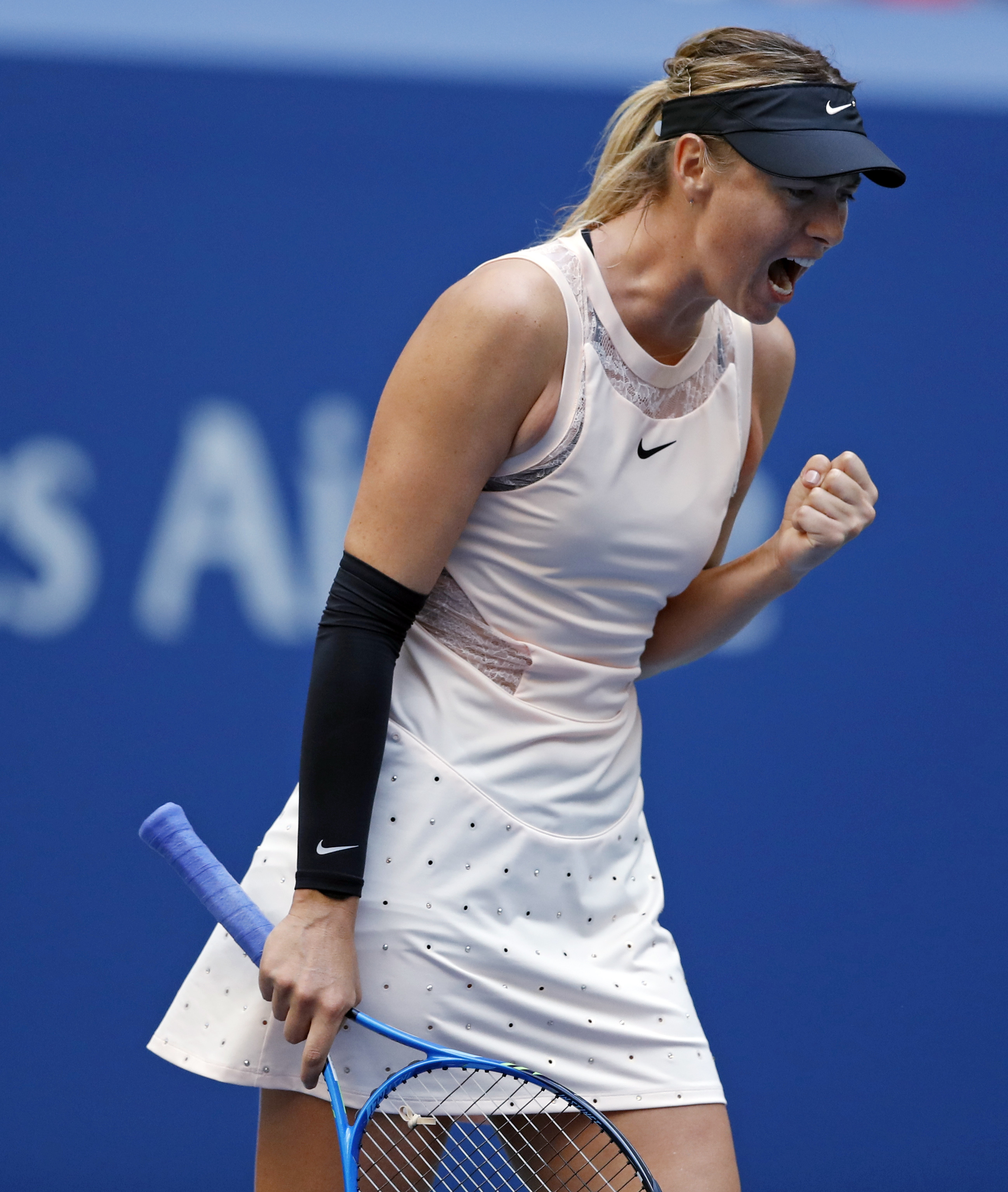 Maria Sharapova, of Russia, reacts after scoring a point against Timea Babos, of Hungary, during the second round of the U.S. Open tennis tournament, Wednesday, Aug. 30, 2017, in New York. (AP Photo/Adam Hunger)
