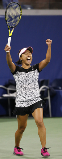 Kurumi Nara, of Japan, reacts after upsetting Svetlana Kuznetsova, of Russia, during a match at the U.S. Open tennis tournament in New York, Thursday, Aug. 31, 2017. (AP Photo/Kathy Willens)