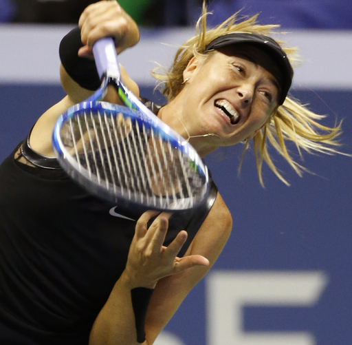 Maria Sharapova, of Russia, follows through on a serve during the second set against Sofia Kenin, of the United States, at the U.S. Open tennis tournament in New York, Friday, Sept. 1, 2017. Sharapova defeated Kenin 7-6, 6-2. (AP Photo/Kathy Willens)