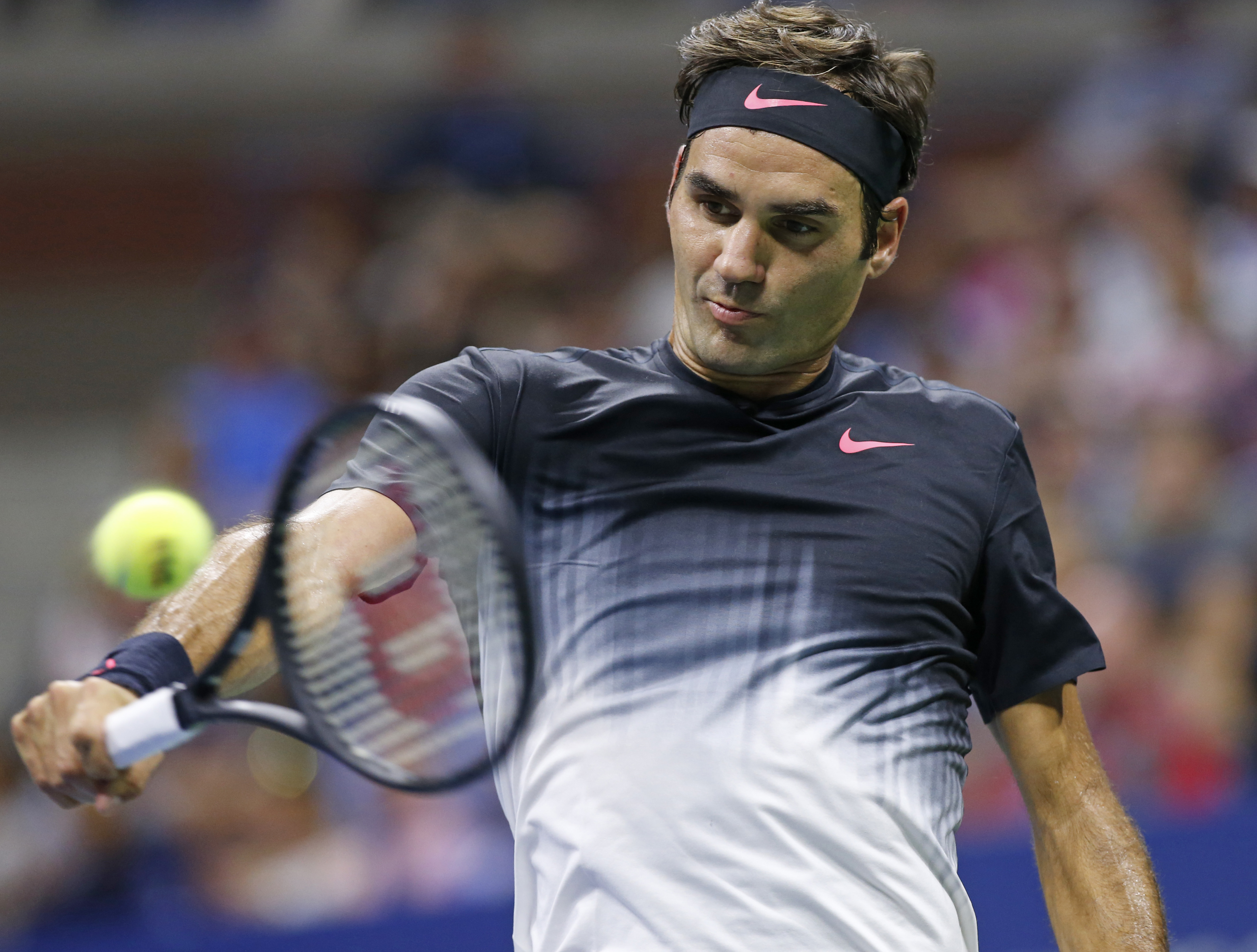 Roger Federer, of Switzerland, returns in a fourth-round match against Philipp Kohlschreiber, of Germany, at the U.S. Open tennis tournament in New York, Monday, Sept. 4, 2017. (AP Photo/Kathy Willens)