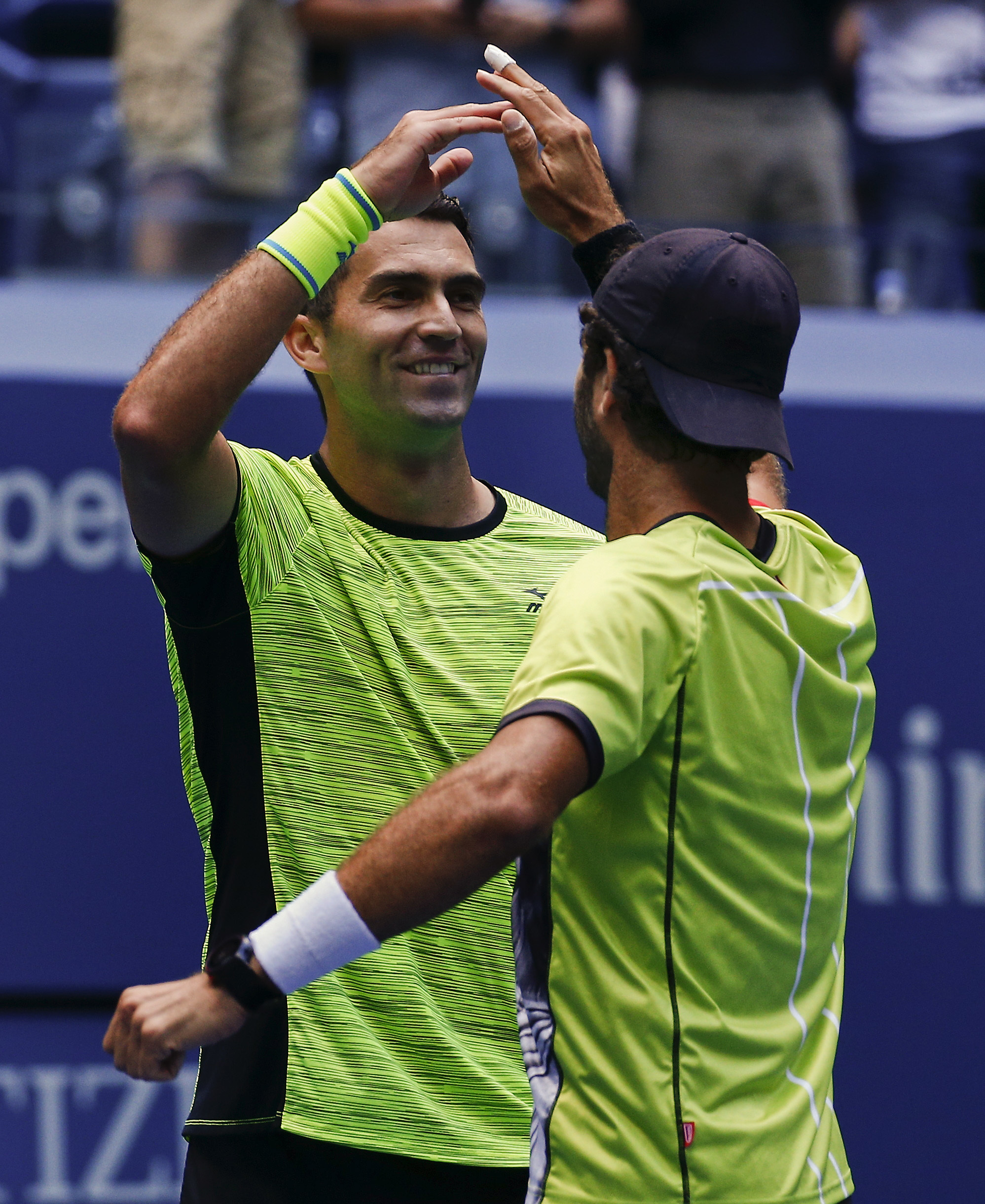 Horia Tecau, of Romania, left, and Jean-Julien Rojer, of Holland, celebrate after beating Feliciano Lopez, of Spain, and Marc Lopez in the doubles final of the U.S. Open tennis tournament, Friday, Sept. 8, 2017, in New York. (AP Photo/Julie Jacobson)