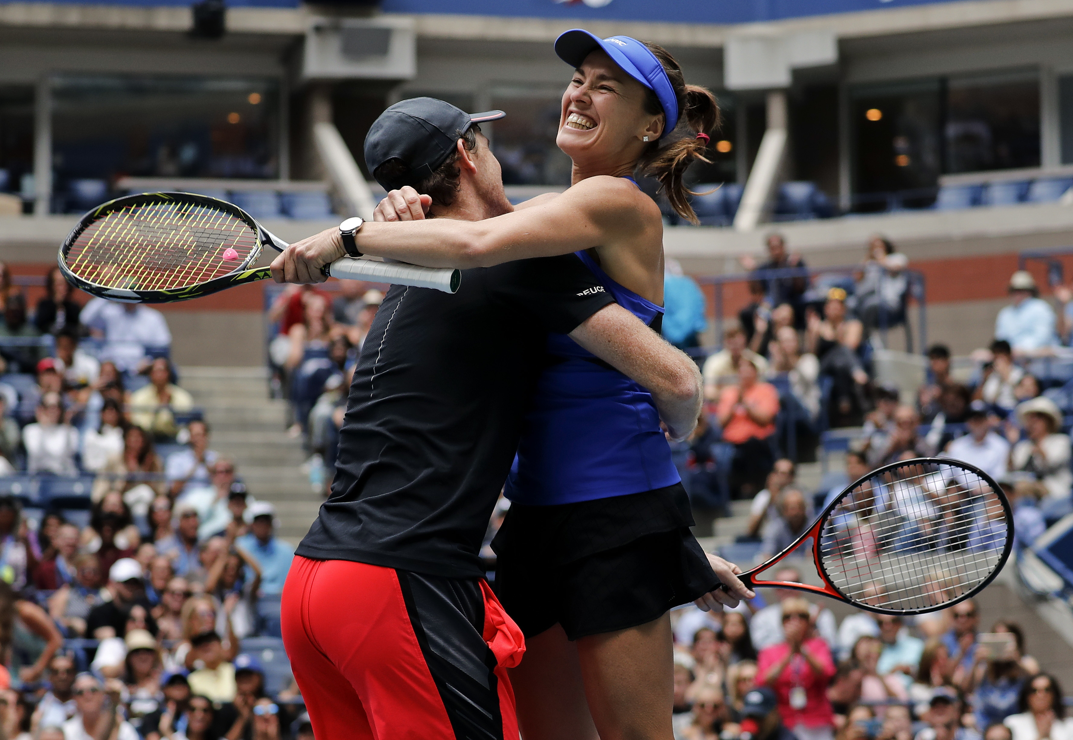 Martina Hingis, of Switzerland, right, celebrates with Jamie Murray, of Great Britain, after winning the mixed doubles final of the U.S. Open tennis tournament against Chan Has-Ching, of Taiwan, and Michael Venus, of New Zealand, Saturday, Sept. 9, 2017,