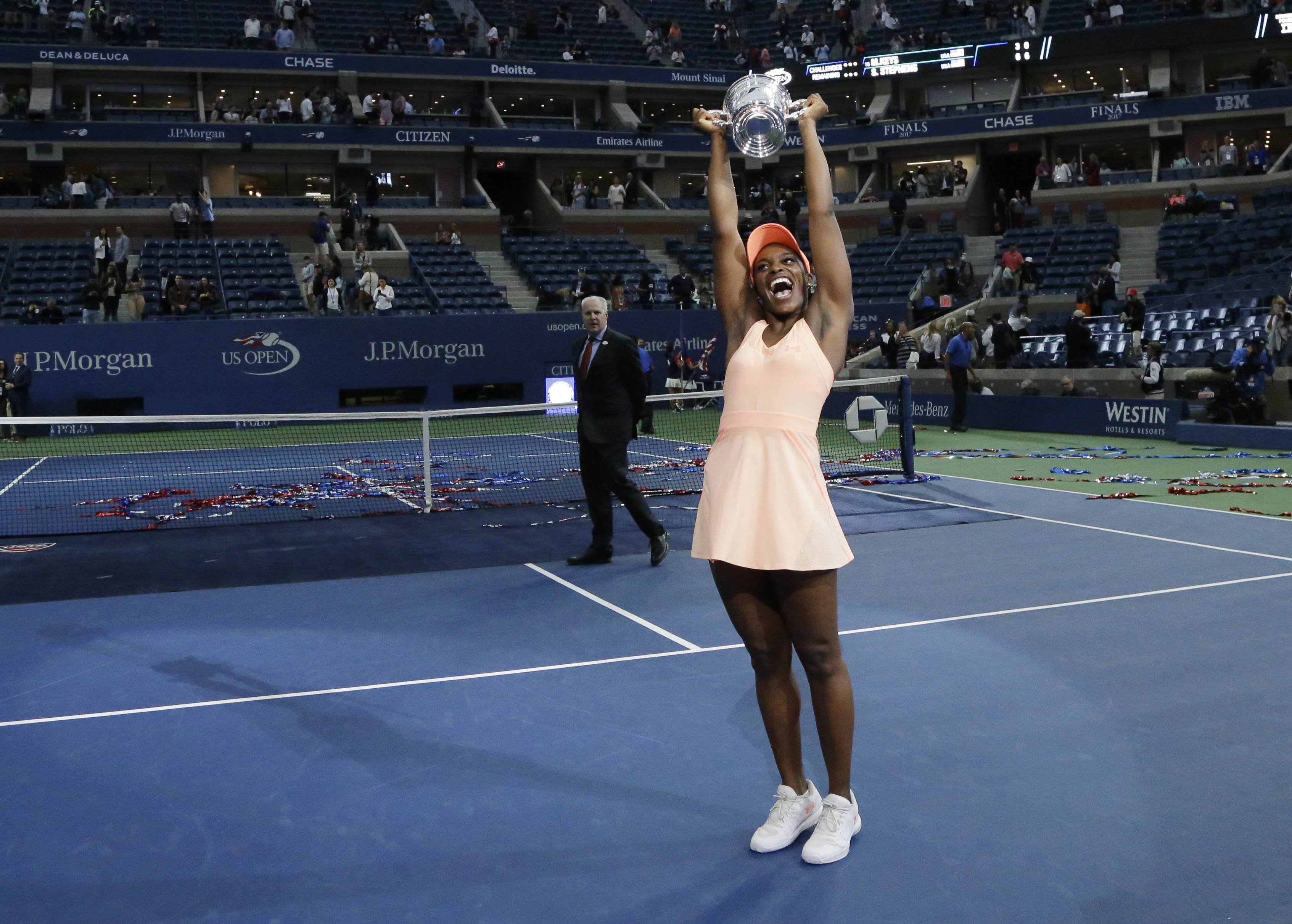 Sloane Stephens, of the United States, holds up the championship trophy after the women's singles final of the U.S. Open tennis tournament, Saturday, Sept. 9, 2017, in New York. Stephens beat Madison Keys, of the United States. (AP Photo/Julio Cortez)