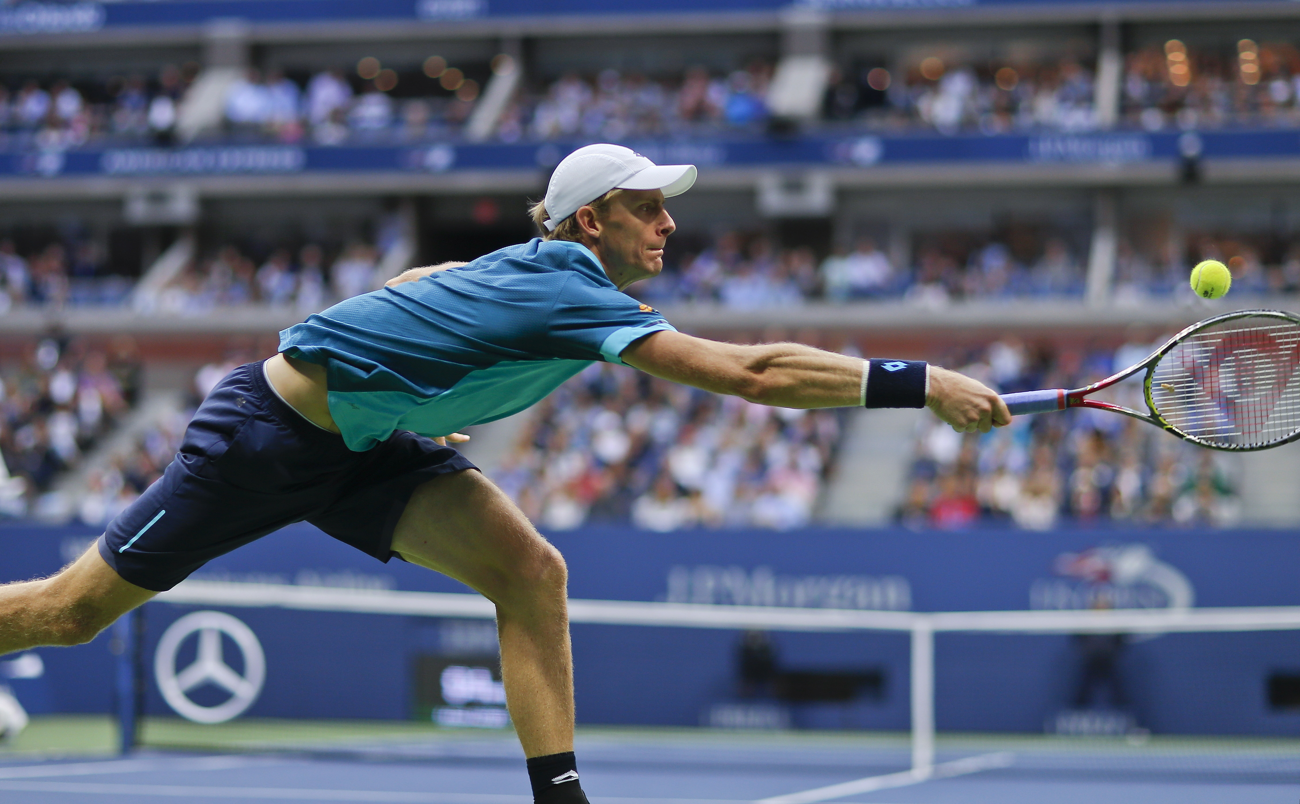 Kevin Anderson, of South Africa, returns a shot from Rafael Nadal, of Spain, during the men's singles final of the U.S. Open tennis tournament, Sunday, Sept. 10, 2017, in New York. (AP Photo/Andres Kudacki)