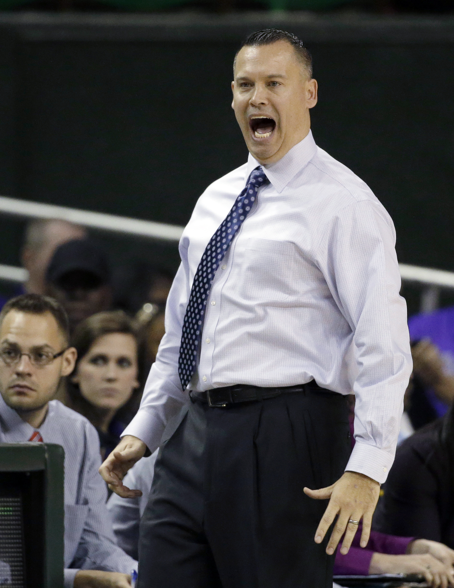 Stephen F. Austin head coach Brandon Schneider shouts adjustments to his team's defense in the second half of an NCAA college basketball game against Baylor, Sunday, Dec. 14, 2014, in Waco, Texas. (AP Photo/Tony Gutierrez)