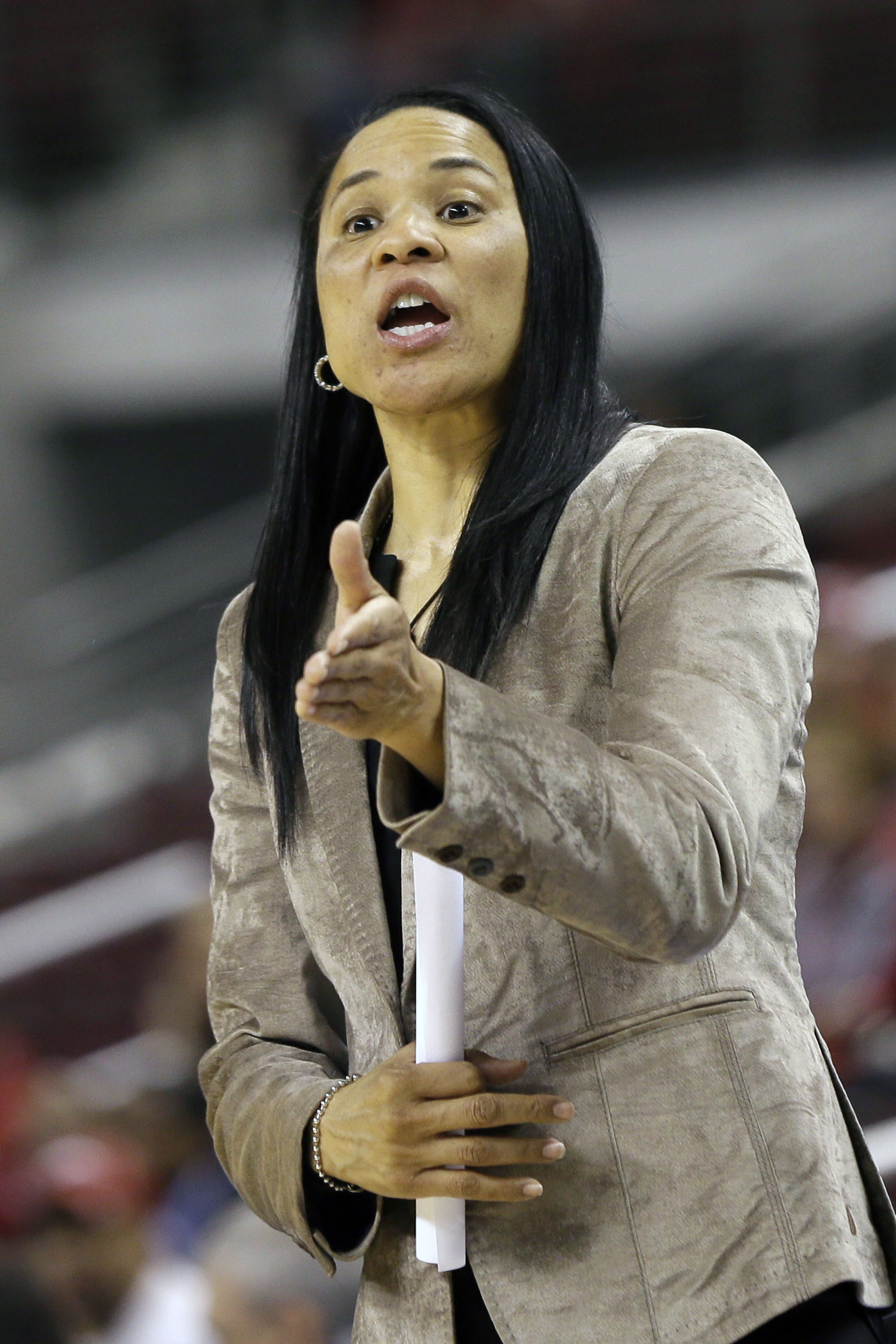 FILE - In this Friday, March 6, 2015 file photo, South Carolina coach Dawn Staley talks to players in the first half of a Southeastern Conference women's tournament NCAA college basketball game against Arkansas in North Little Rock, Ark. South Carolina co